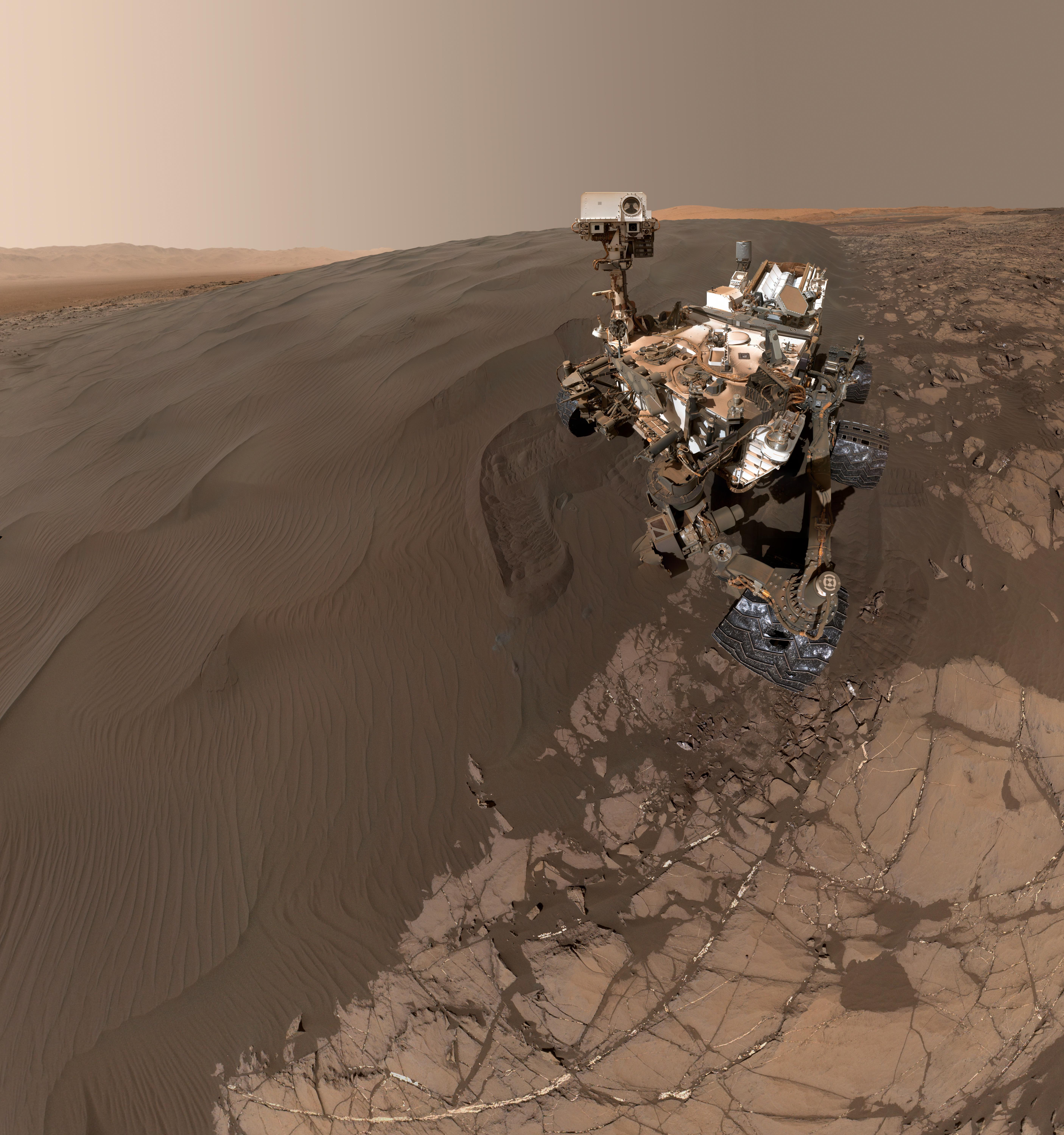 This self-portrait of NASA's Curiosity Mars rover shows the vehicle at  Namib Dune,  where the rover's activities included scuffing into the dune with a wheel and scooping samples of sand for laboratory analysis.