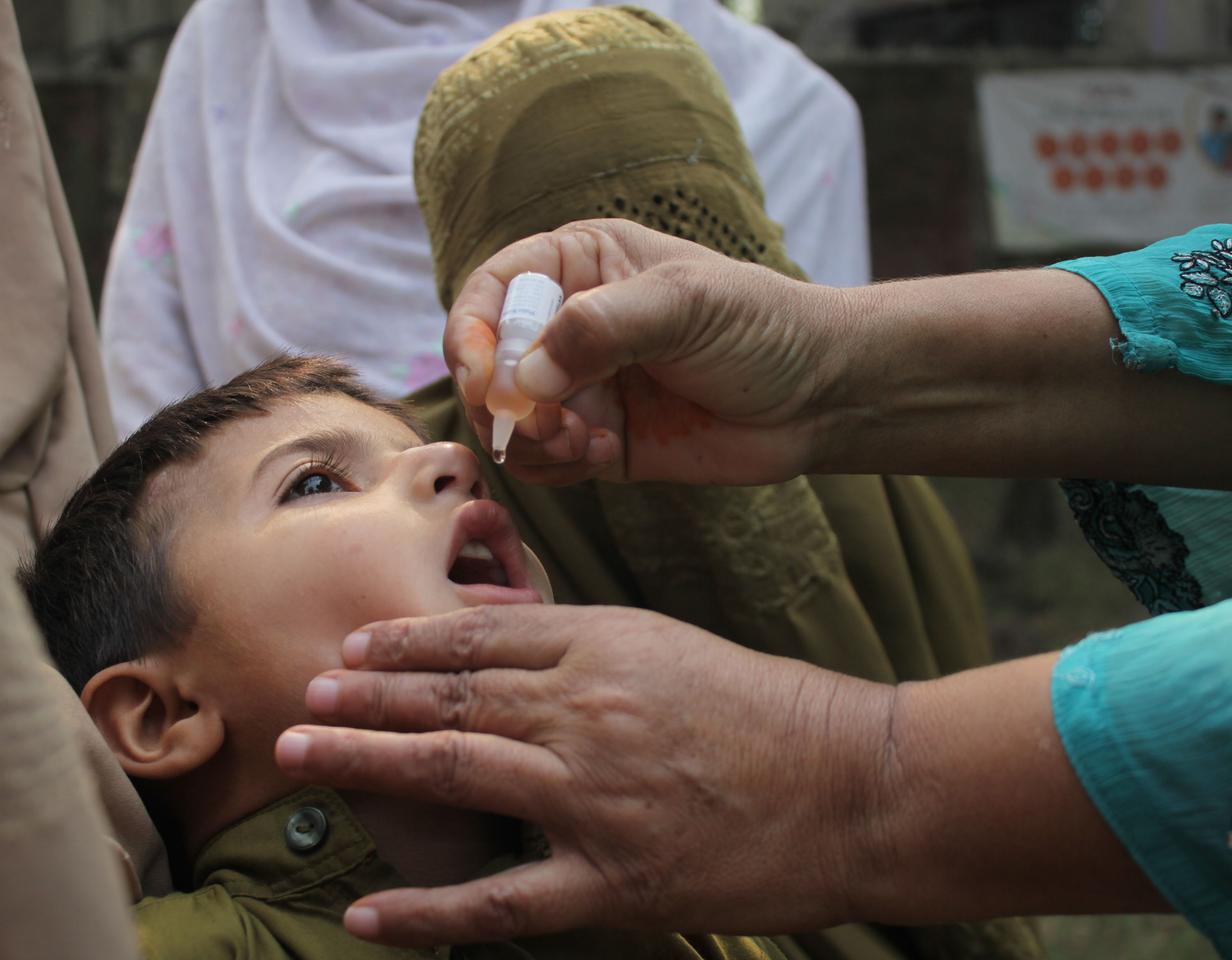 All good now: A child in Lahore, Pakistan receives the polio vaccine in 2014