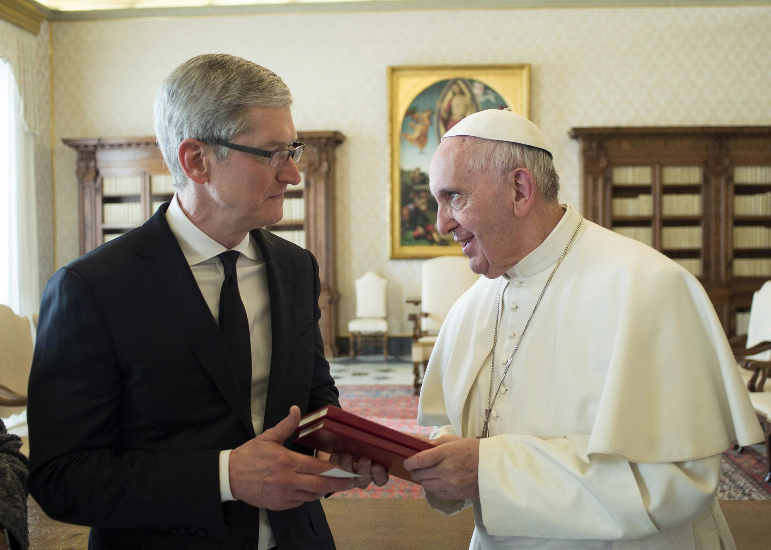 Pope Francis talks with Apple CEO Tim Cook during a private audience in the Vatican, on Jan. 22, 2016.