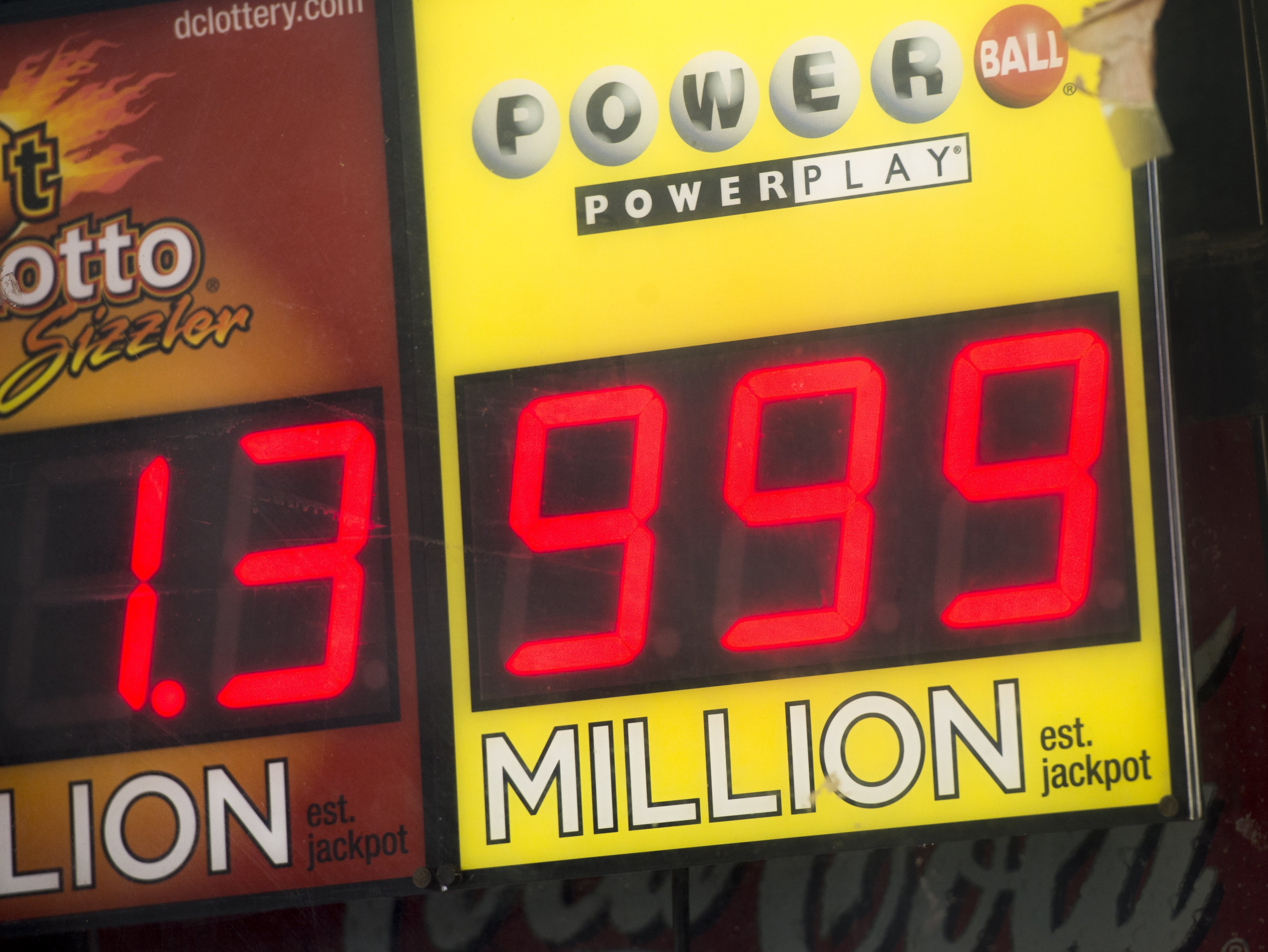 A sign showing a Powerball prize of $999 million, the largest jackpot winnings that the Powerball sign can display, with the actual Powerball jackpot estimated at $1.3 billion, outside a deli in Washington, DC on Jan 11.