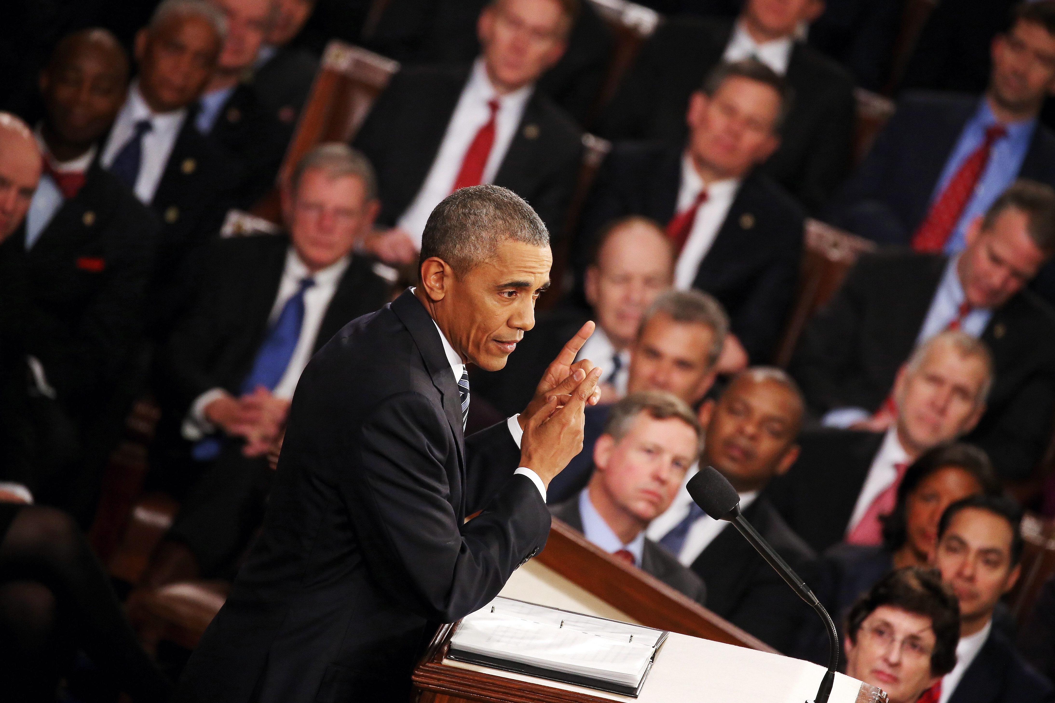 President Barack Obama gestures as he delivers the State of the Union speech before members of Congress in the House chamber of the U.S. Capitol on Jan. 12, 2016 in Washington.
