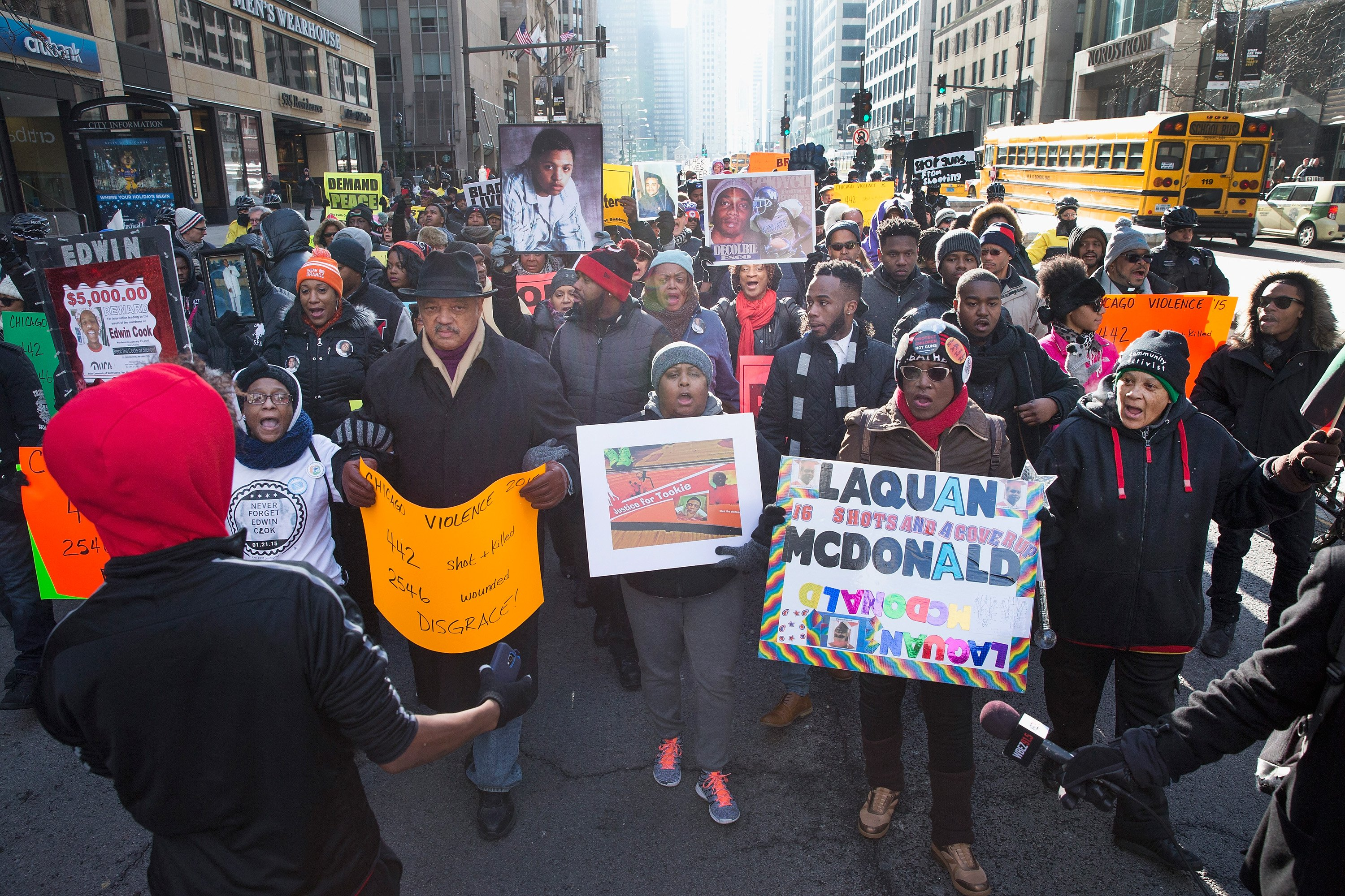 Rev. Jesse Jackson helps to lead demonstrators calling for an end to gun violence as they march through downtown Chicago on Dec. 31, 2015. The shooting deaths by police of a 19-year-old college student Quintonio LeGrier and his 55-year-old neighbor Bettie Jones and a recently released video showing the shooting of 17-year-old Laquan McDonald by Chicago Police officer Jason Van Dyke have sparked dozens of protests in the city.