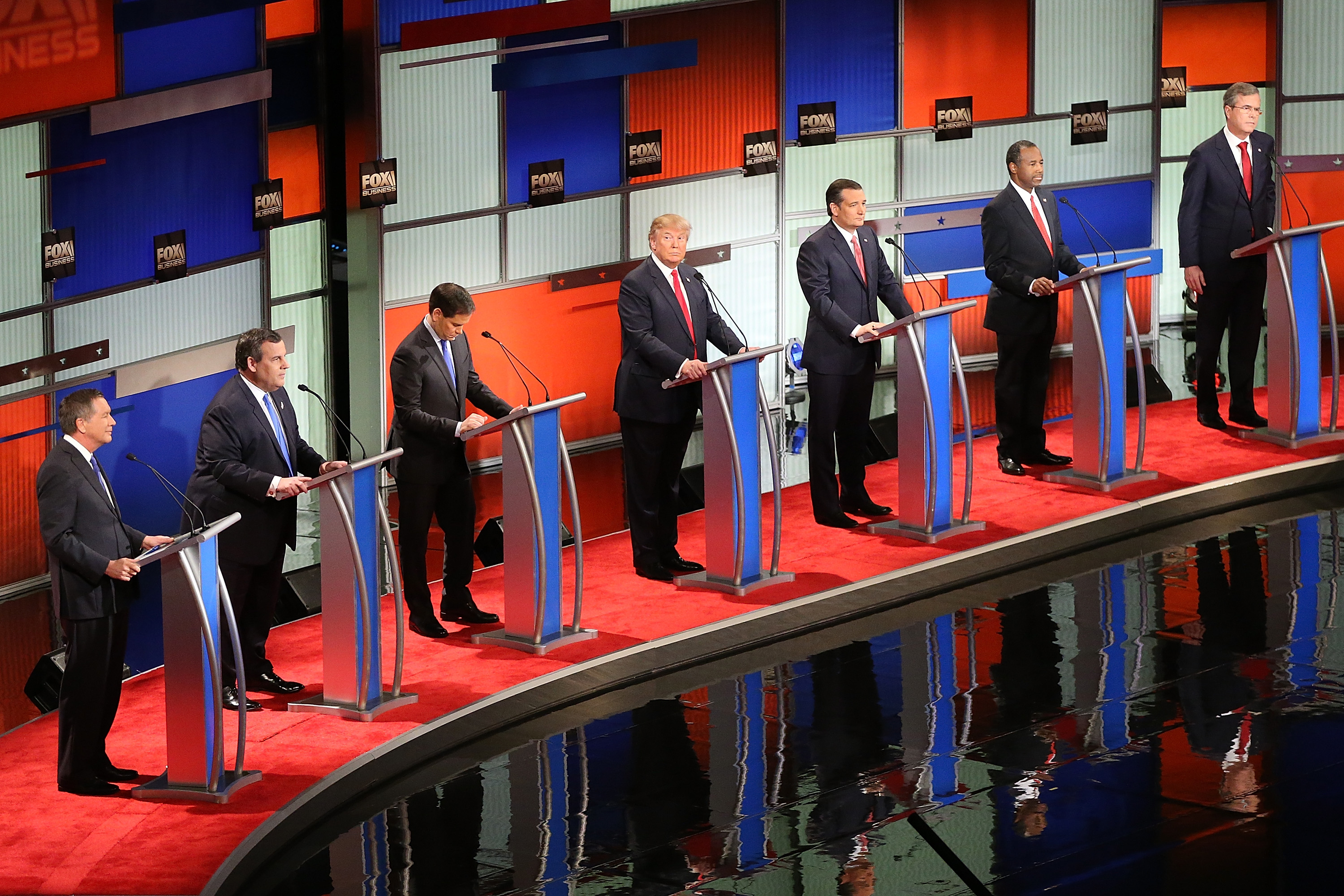 Republican presidential candidates (L-R) Ohio Governor John Kasich, New Jersey Governor Chris Christie, Sen. Marco Rubio (R-FL), Donald Trump, Sen. Ted Cruz (R-TX), Ben Carson and Jeb Bush participate in the Fox Business Network Republican presidential debate at the North Charleston Coliseum and Performing Arts Center in North Charleston, South Carolina, on Jan. 14, 2016