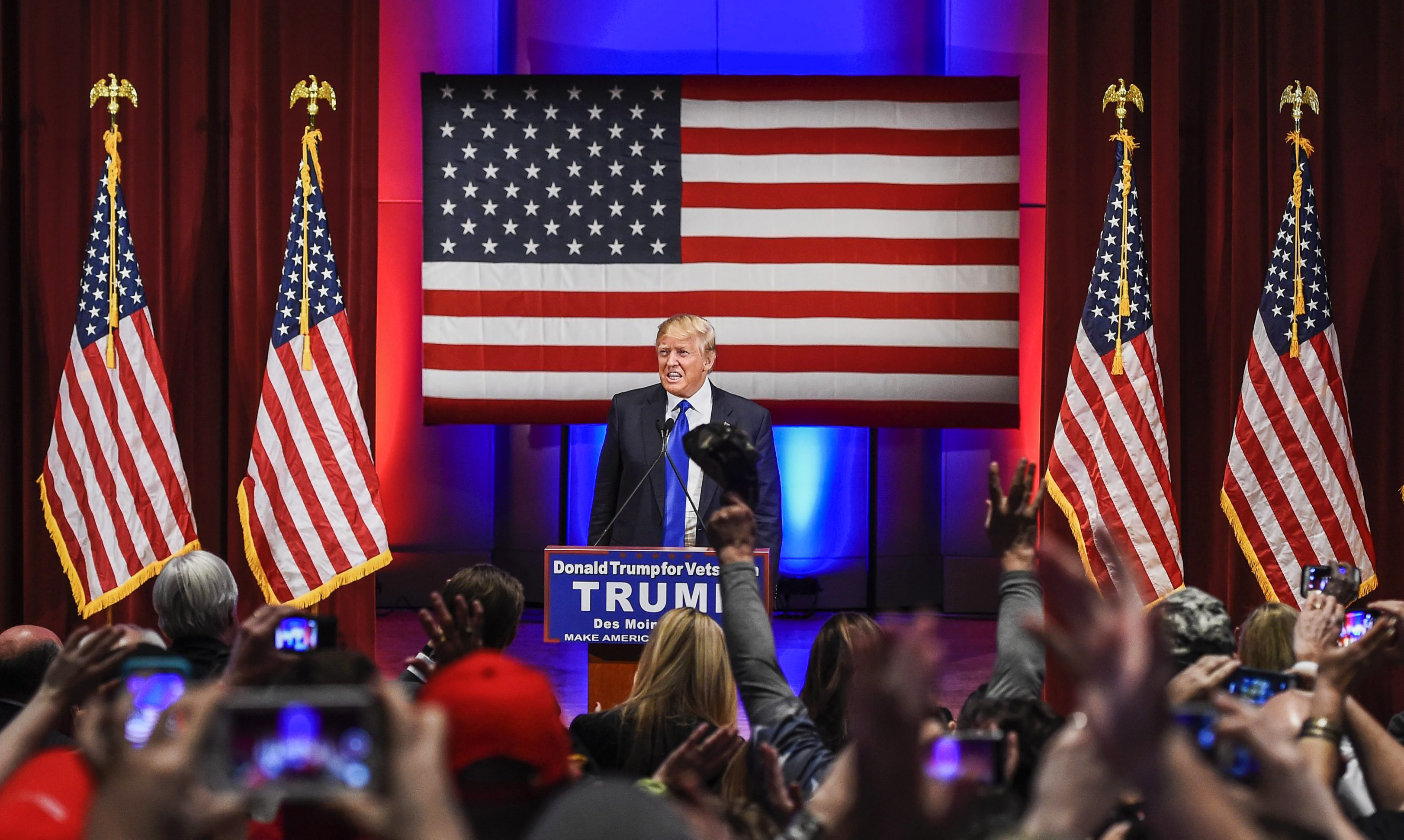 Republican presidential candidate Donald Trump is applauded at a special event to benefit veterans organizations at Drake University in Des Moines, Iowa on Jan 28, 2016.