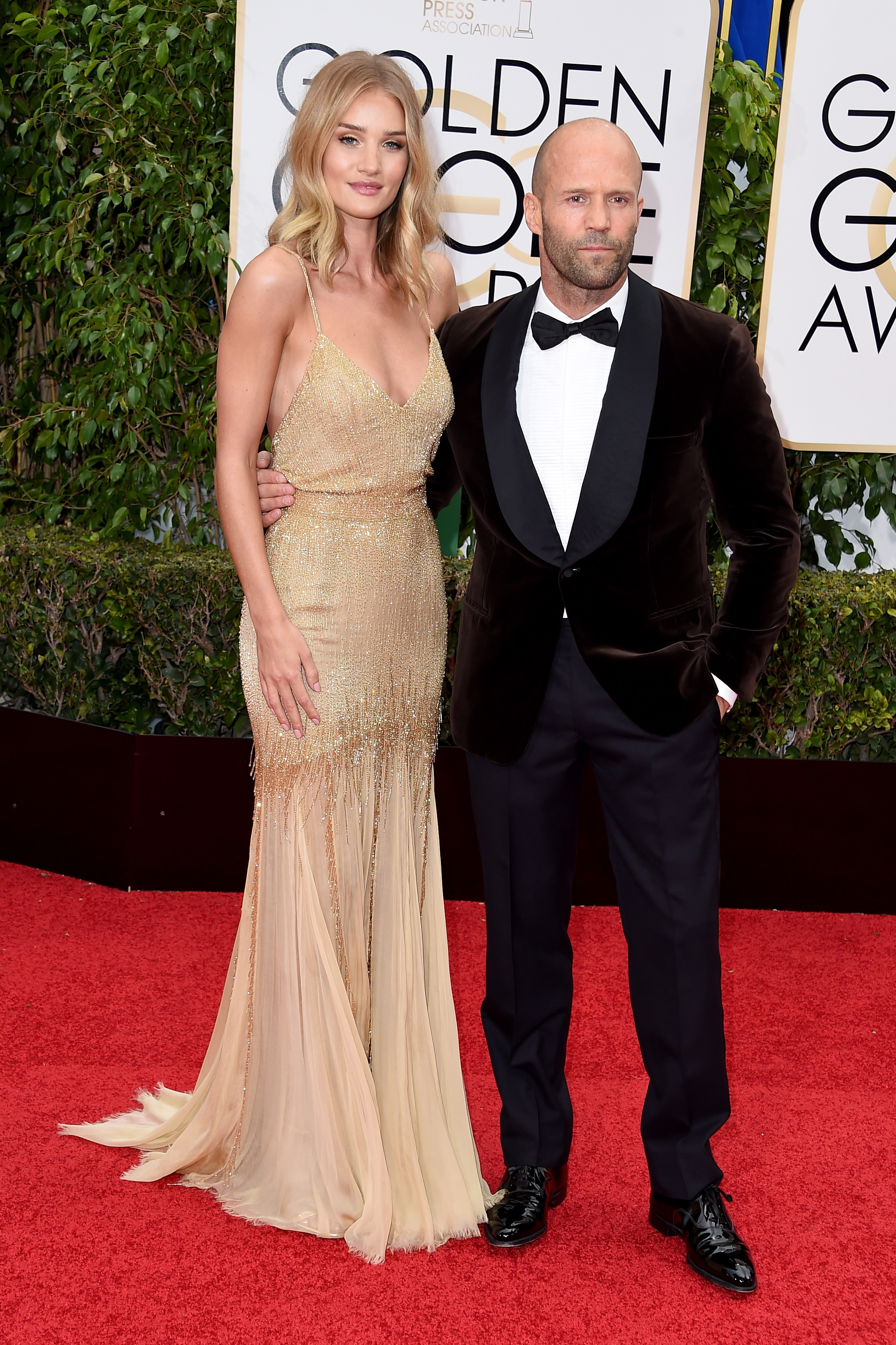 Rosie Huntington-Whiteley and Jason Statham arrive to the 73rd Annual Golden Globe Awards on Jan. 10, 2016 in Beverly Hills.