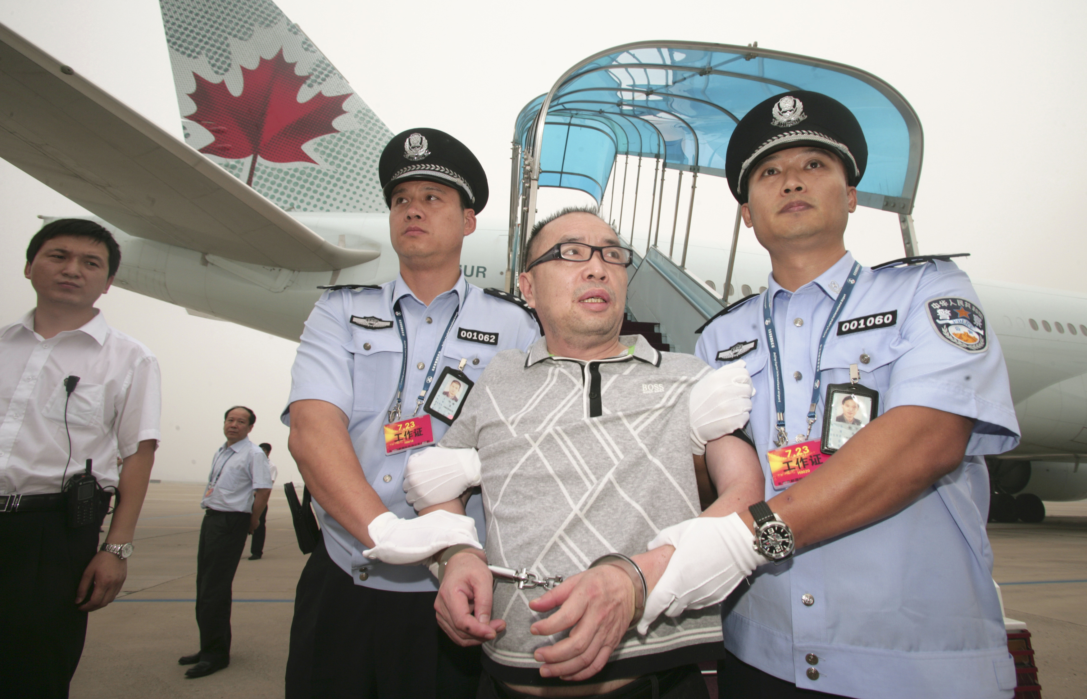 In this file photo, on July 23, 2011, Chinese fugitive Lai Changxing at Beijing International Airport after he was flown back to Beijing from Canada. He was jailed for life the following year