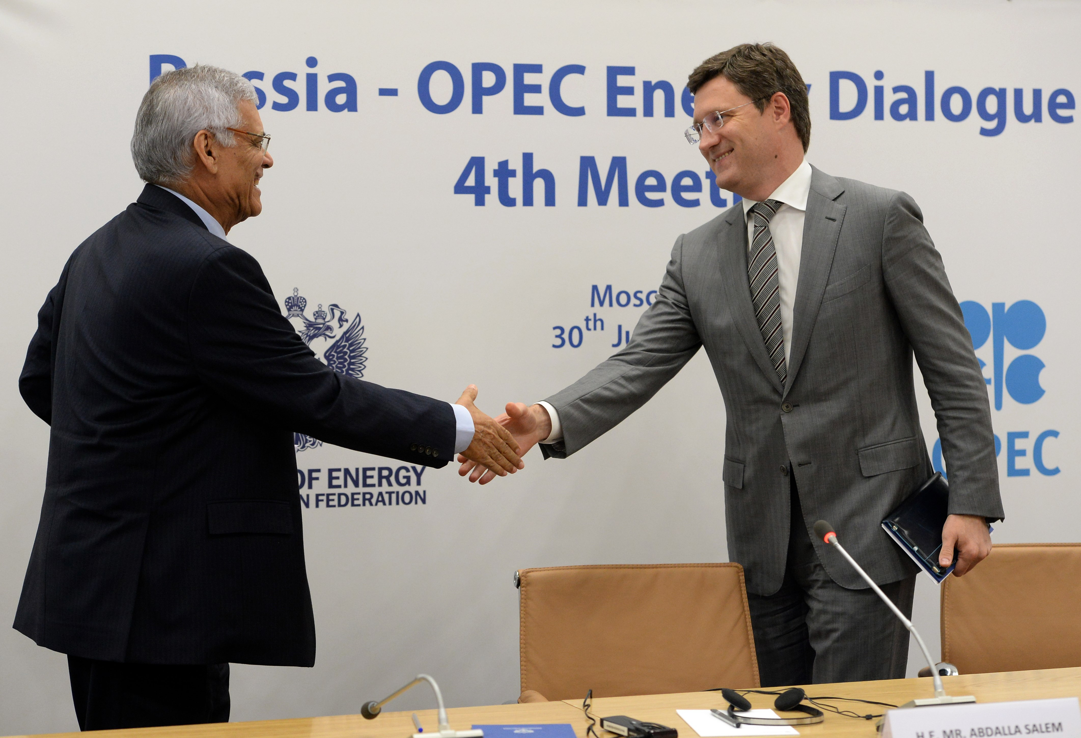 OPEC Secretary-General Abdalla Salem El-Badri and Russia's Energy Minister Alexander Novak shake hands during a press-conference after Russia-OPEC energy dialogue meeting in Moscow on July 30, 2015.