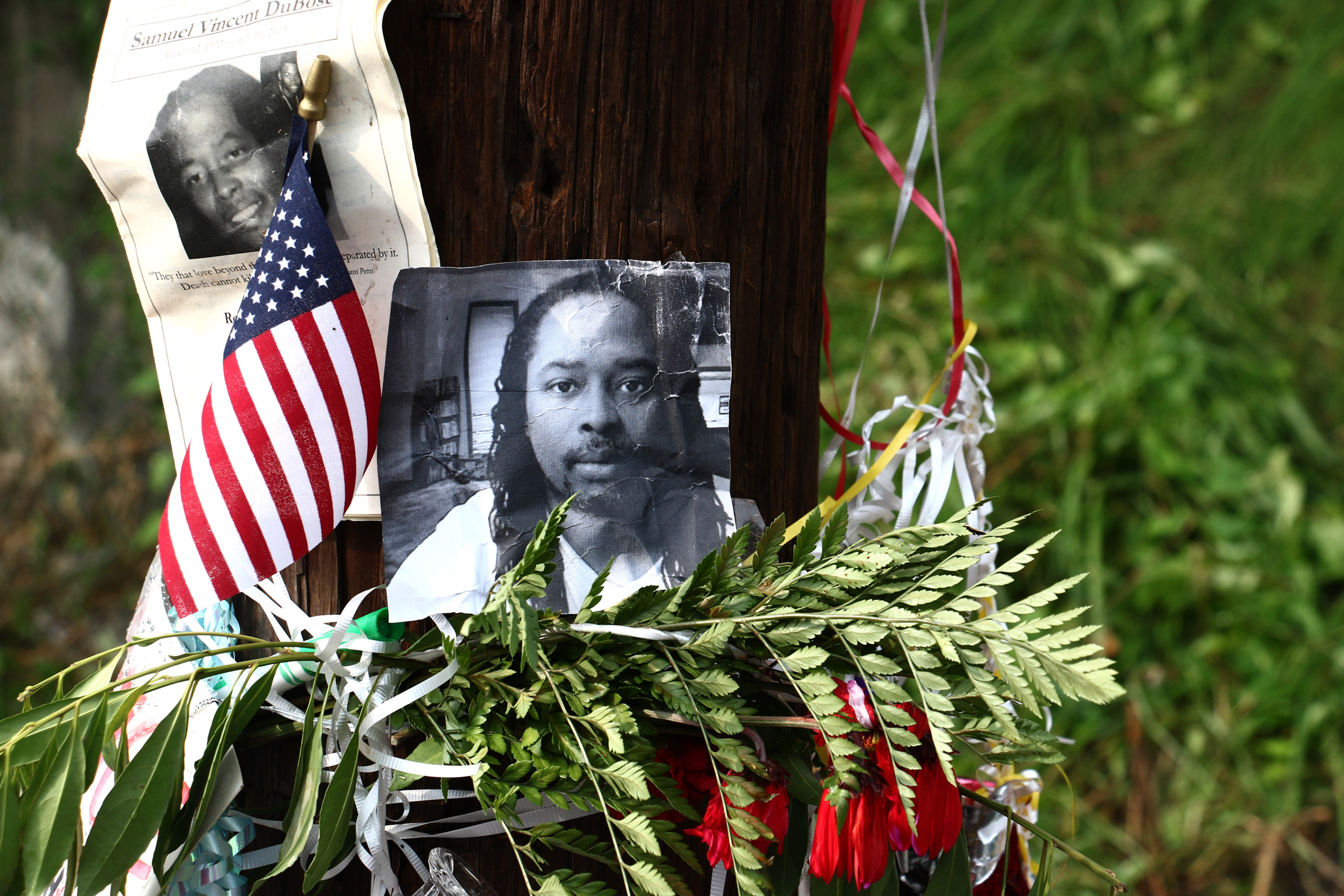 Photos of Samuel DuBose hang on a pole at a memorial  in Cincinnati on July 29, 2015.