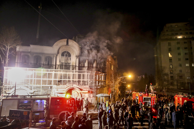 Smoke rises as Iranian protesters, upset over the execution of Shiite cleric Nimr al-Nimr in Saudi Arabia, set fire to the Saudi embassy in Tehran on Jan. 3, 2016.