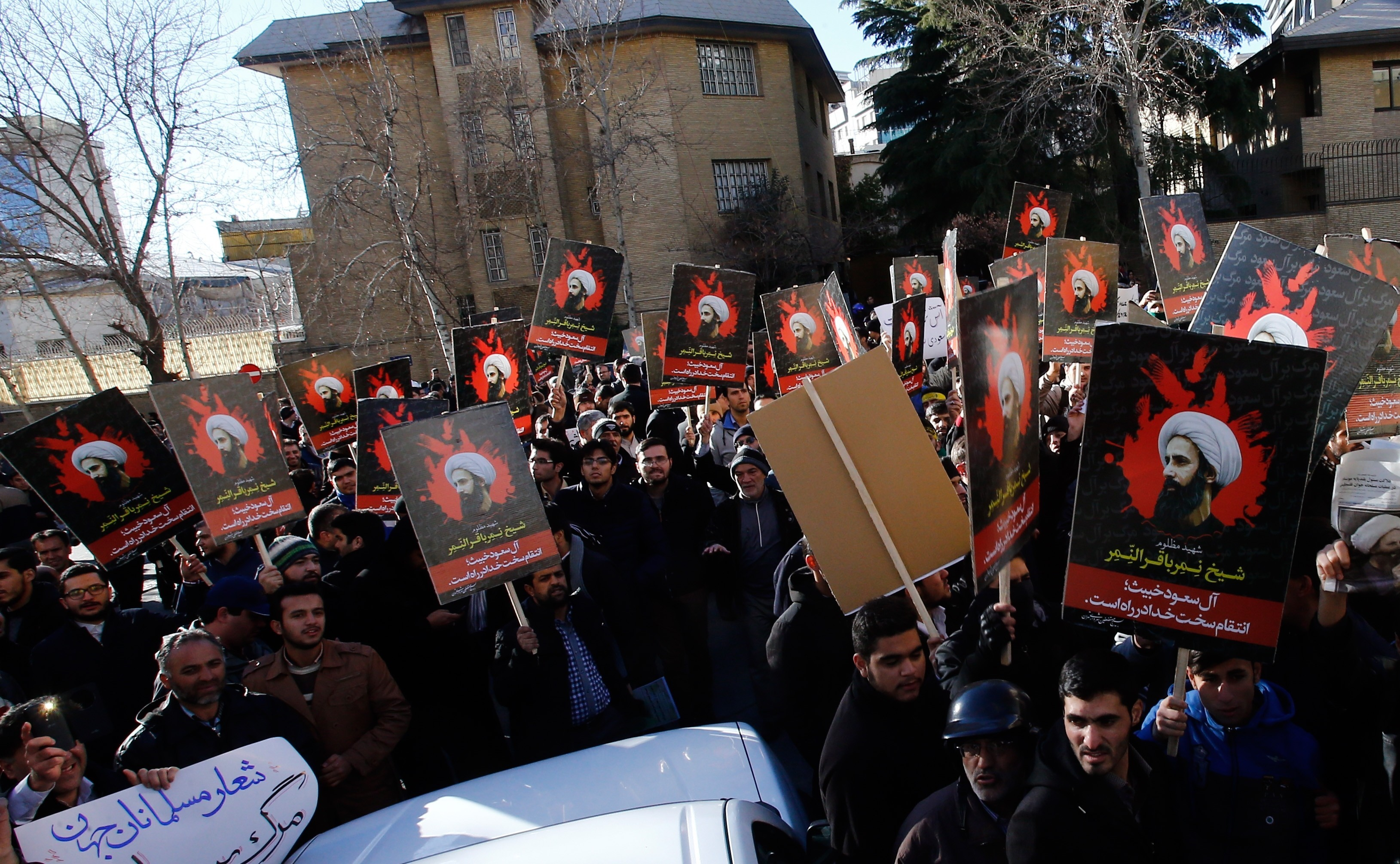 Demonstrators hold posters of Nimr Baqir al-Nimr and shout slogans during a protest rally outside the embassy of Saudi Arabia against the execution of prominent Saudi Shia cleric Nimr Baqir al-Nimr by Saudi authorities, in Tehran, Iran on Jan. 3 2016.