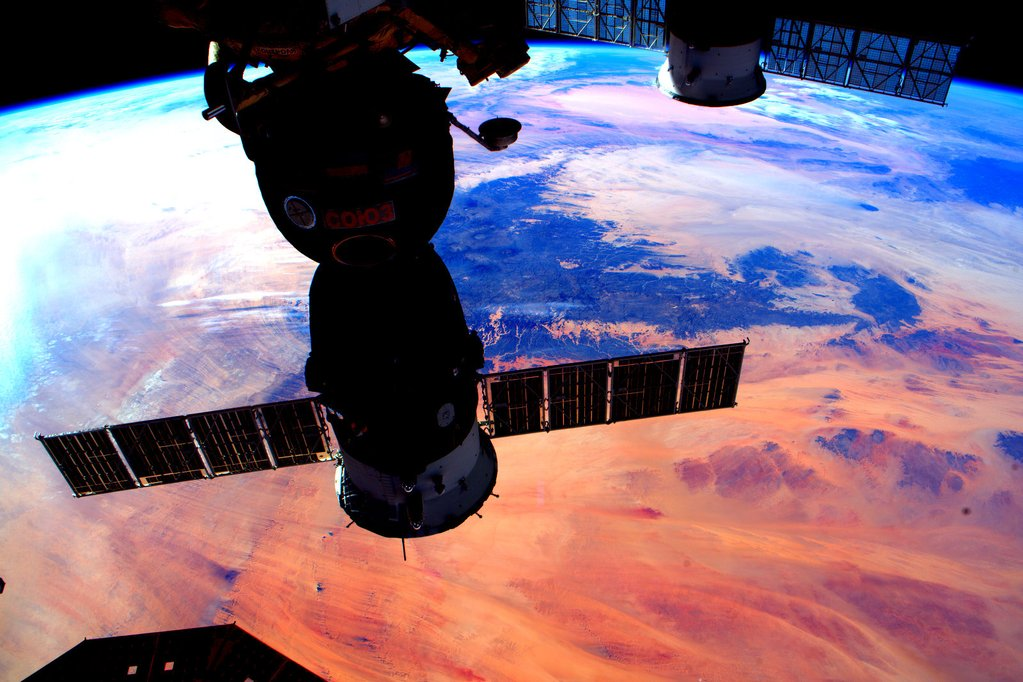 Day 282. Soyuz silhouette and #sunset colors of our magnificent #Earth. #GoodNight from @space_station! #YearInSpace  - via Twitter on Jan. 3, 2016