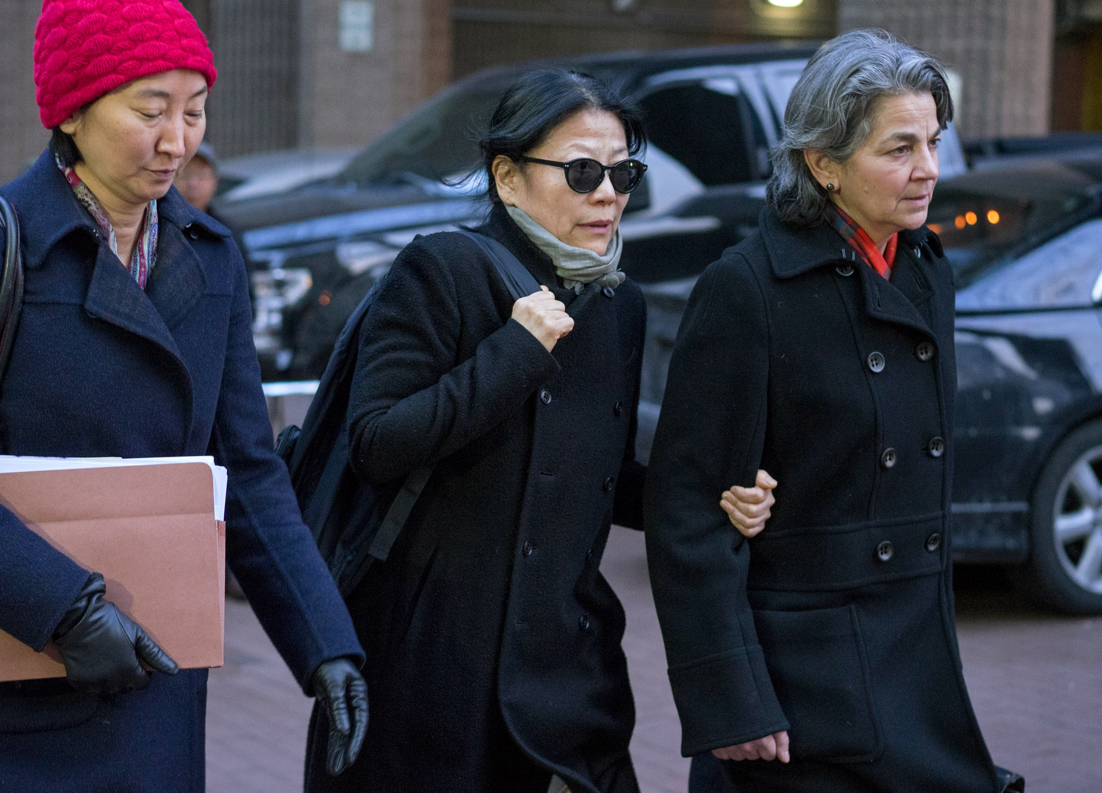 Shiwei Yan, CEO of Global Sustainability Foundation, center, leaves federal court in New York after she plead guilty in connection with a scheme to bribe ex-UN General Assembly President John Ashe on Jan. 20, 2016.