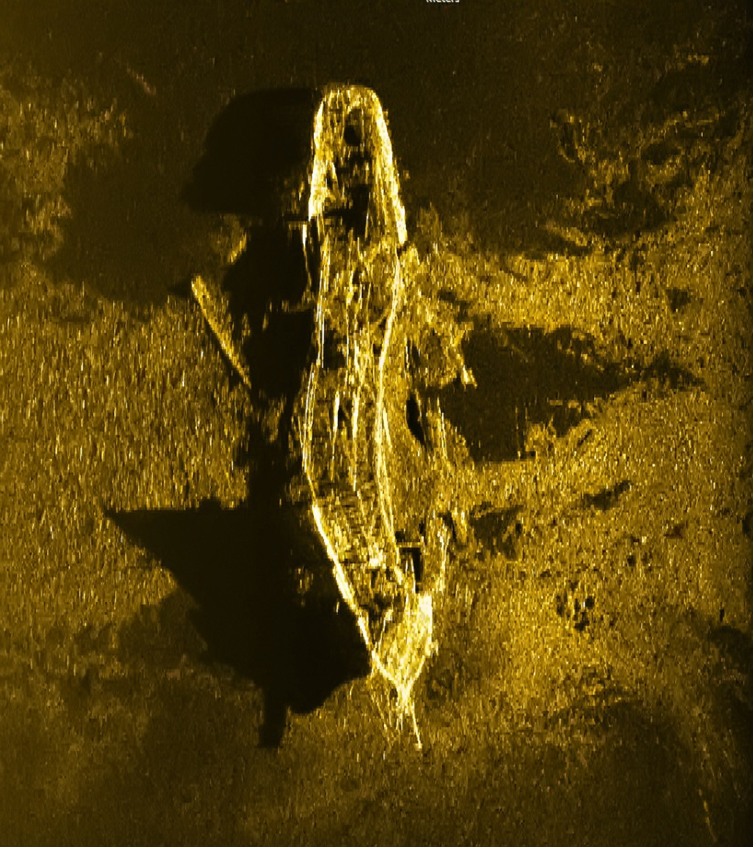 An iron or steel-hulled shipwreck some 3,700 meters below the surface and believed to have gone down at the turn of the 19th century.