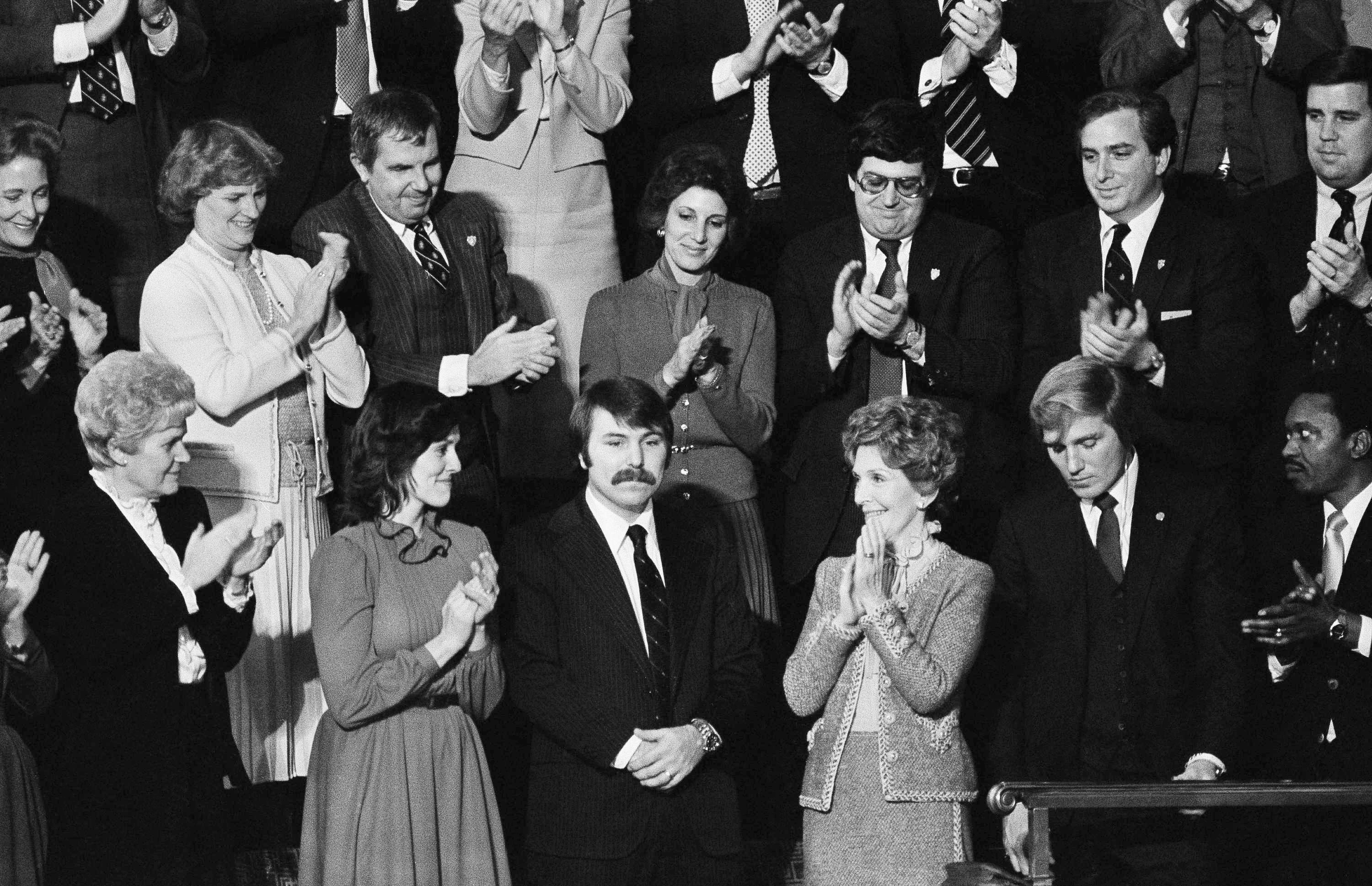 Lenny Skutnik, who jumped into the Potomac River to save one of the passengers aboard an Air Florida jetliner that had crashed there on January 13, 1982, receives applause during Ronald Reagan's State of the Union address on Jan. 27, 1982.
