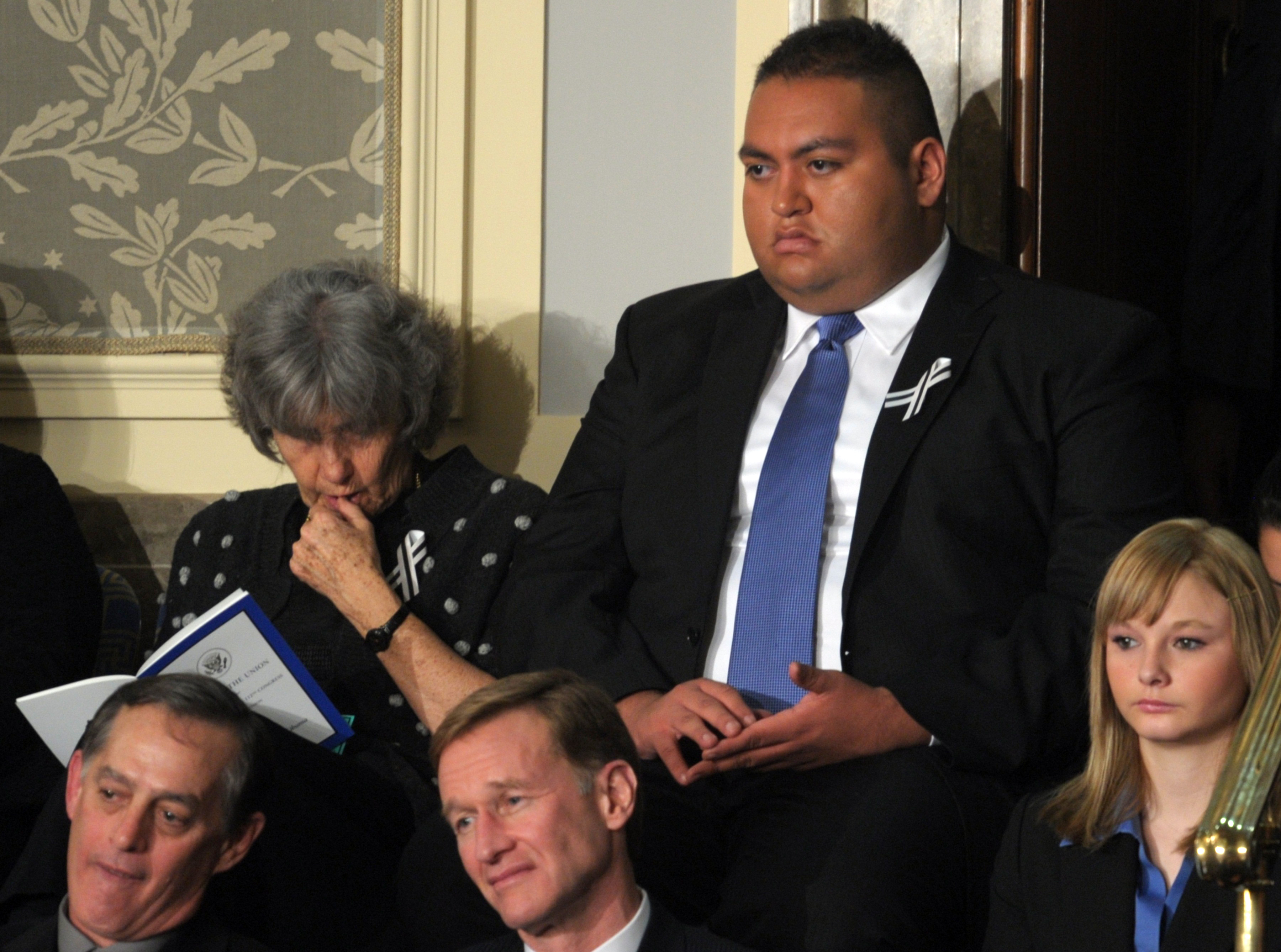 Arizona Rep. Gabrielle Giffords' intern, Daniel Hernandez, listens to President Obama's State of the Union Address on Jan. 25, 2011. Hernandez is credited with saving Giffords' life after she was shot in the head during a constituent meet-and-greet at a Tuscon grocery store.