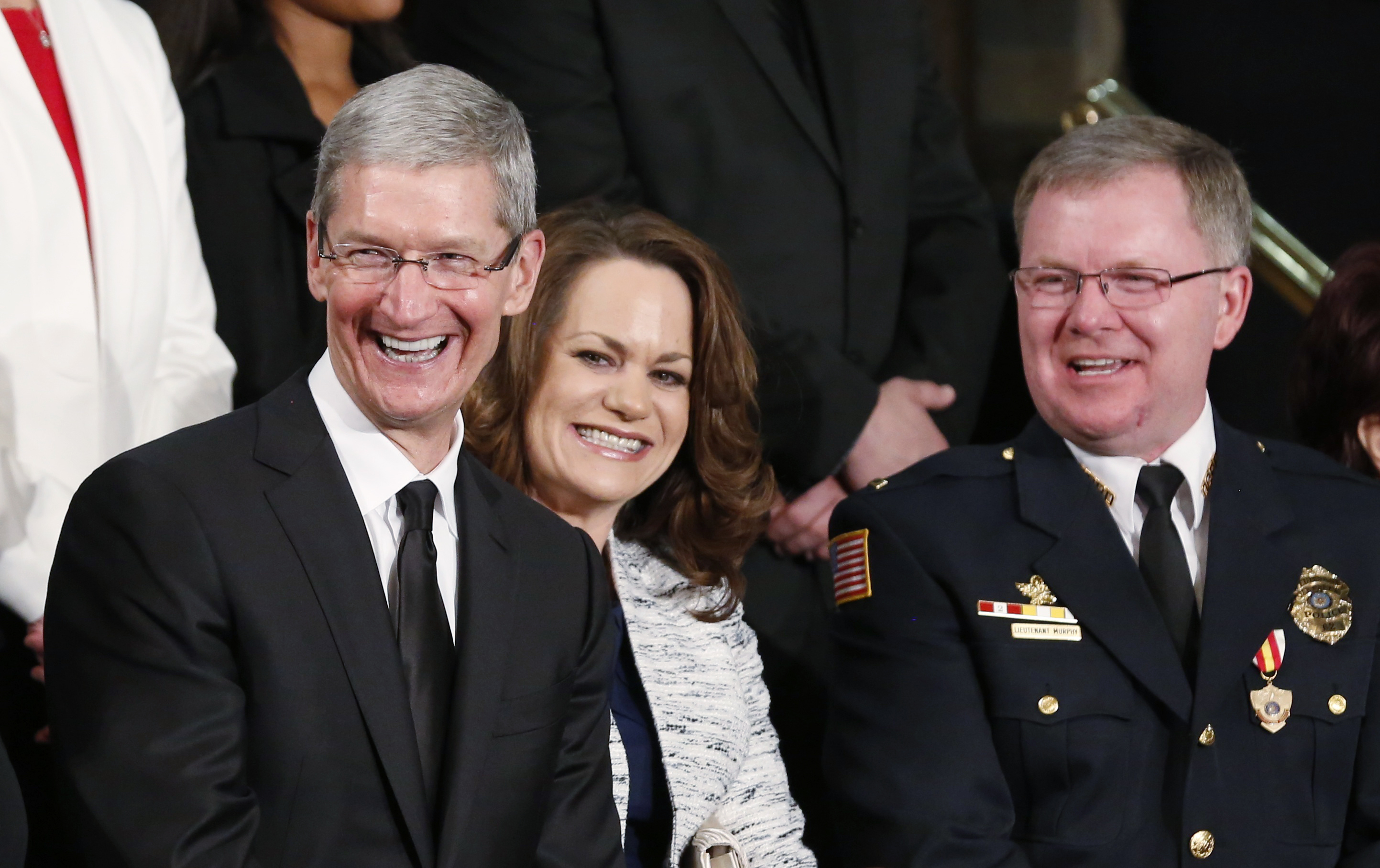Apple CEO Tim Cook is pictured before the State of the Union address by U.S. President Barack Obama on Capitol Hill in Washington, Feb. 12, 2013. Cook announced at the end of last year that Apple will invest $100 million in domestic manufacturing to produce some Macs here.