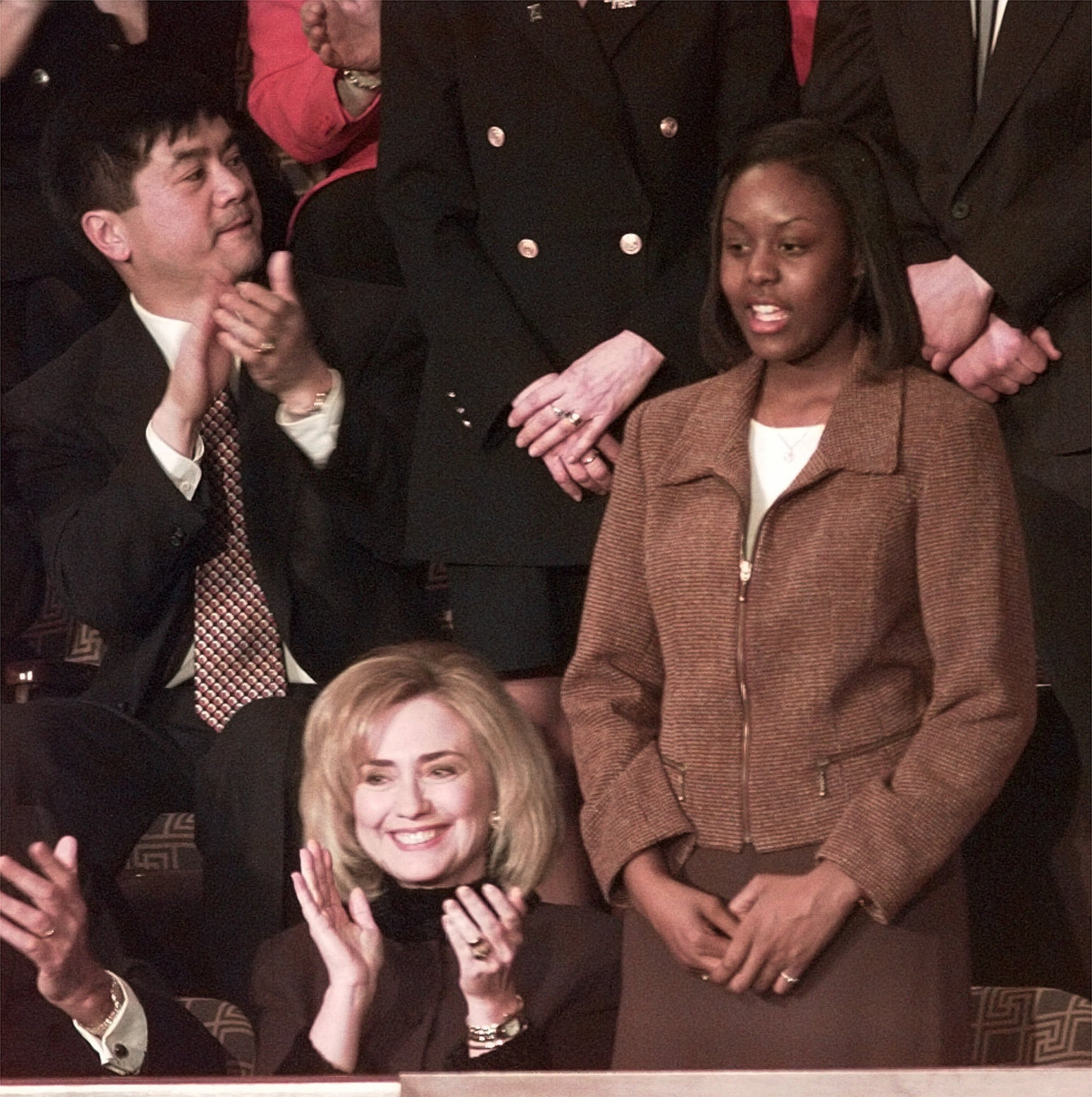Kristin Tanner, an eight grader at Field School in Northbrook, Ill., stands after being introduced during President Clinton's State of the Union Address Tuesday, Feb. 4, 1997, at the Capitol. Tanner was among several Illinois students who tested near the top in the Third International Math and Science Study.