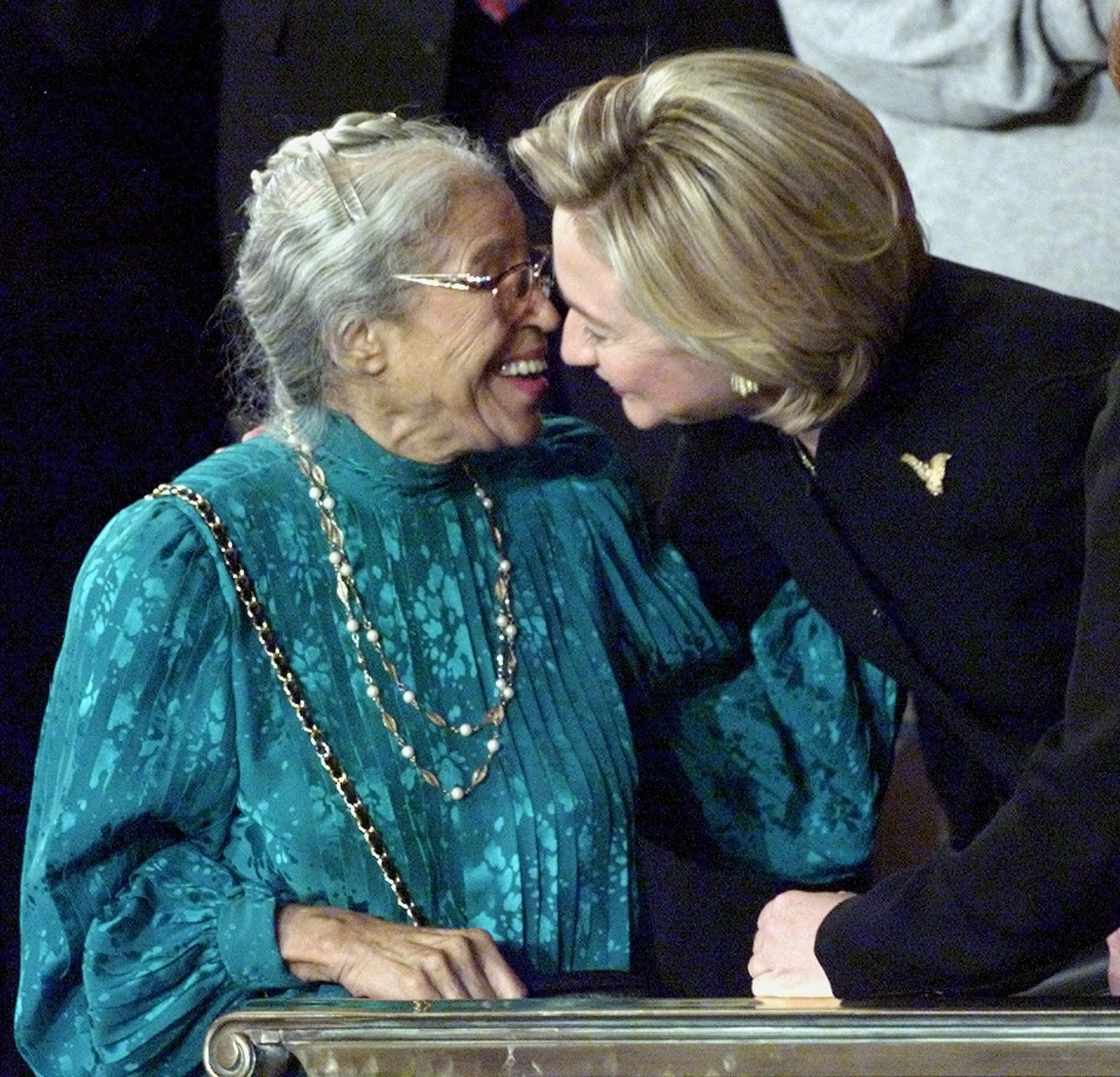 First Lady Hillary Clinton exchanges kisses from Rosa Parks prior to President Bill Clinton's State of the Union address on Capitol Hill, Jan. 19, 1999, in Washington. Clinton invited the Civil Rights icon as a guest while he sought support for his Initiative on Race.