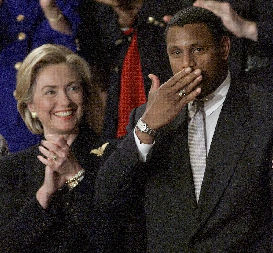 First Lady Hillary Clinton (L) applauds major league baseball player Sammy Sosa, Jan. 19, 1999, during President Clinton's State of the Union address. Months earlier, the Cubs slugger broke Roger Maris' record for the most home runs.
