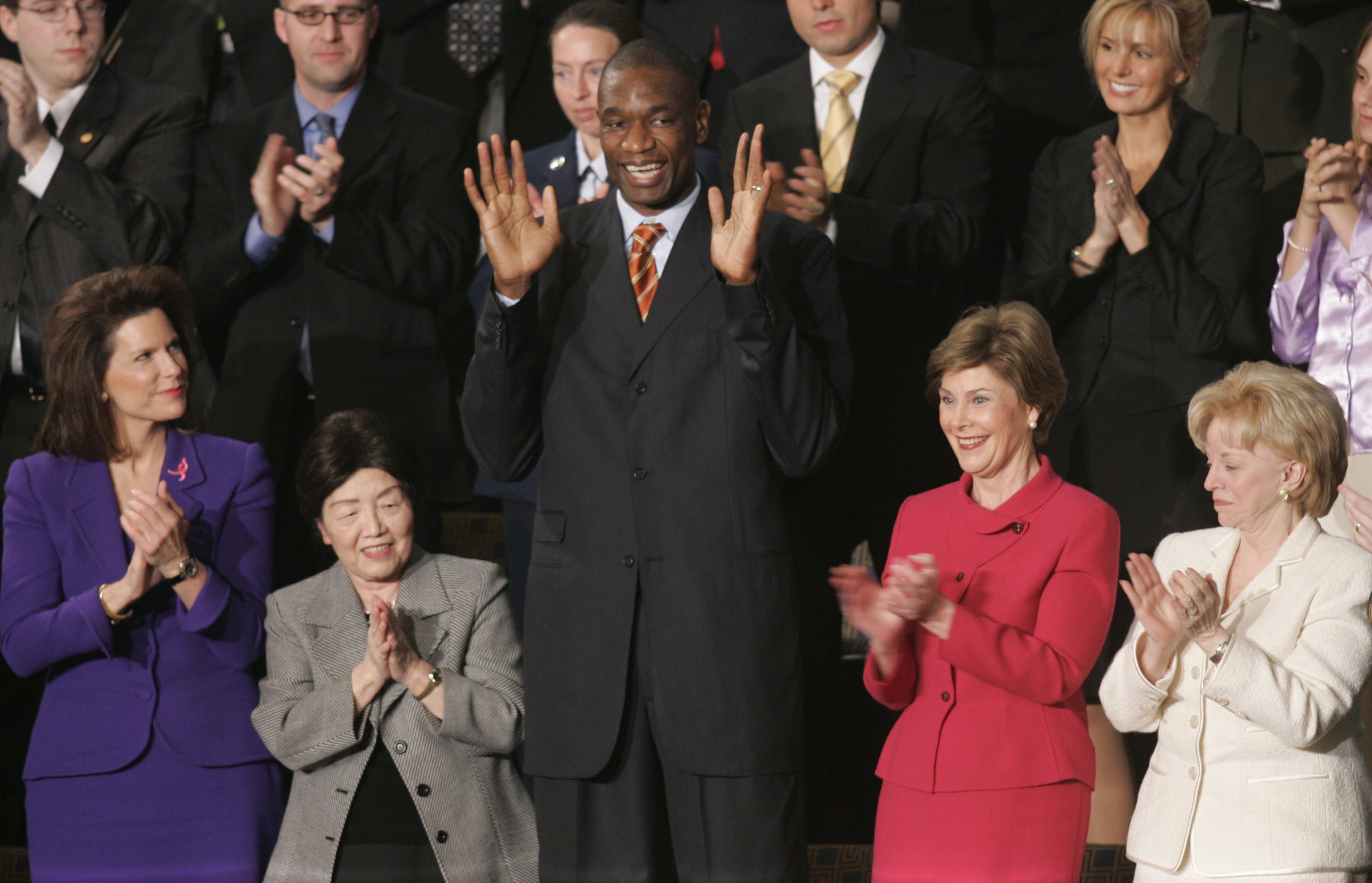 Houston Rockets center and Congolese native Dikembe Mutombo acknowledges the crowd during President Bush's State of the Union address on Capitol Hill in Washington, Jan. 23, 2007. Mutombo raised $29 million to build the African country's newest hospital in 40 years.