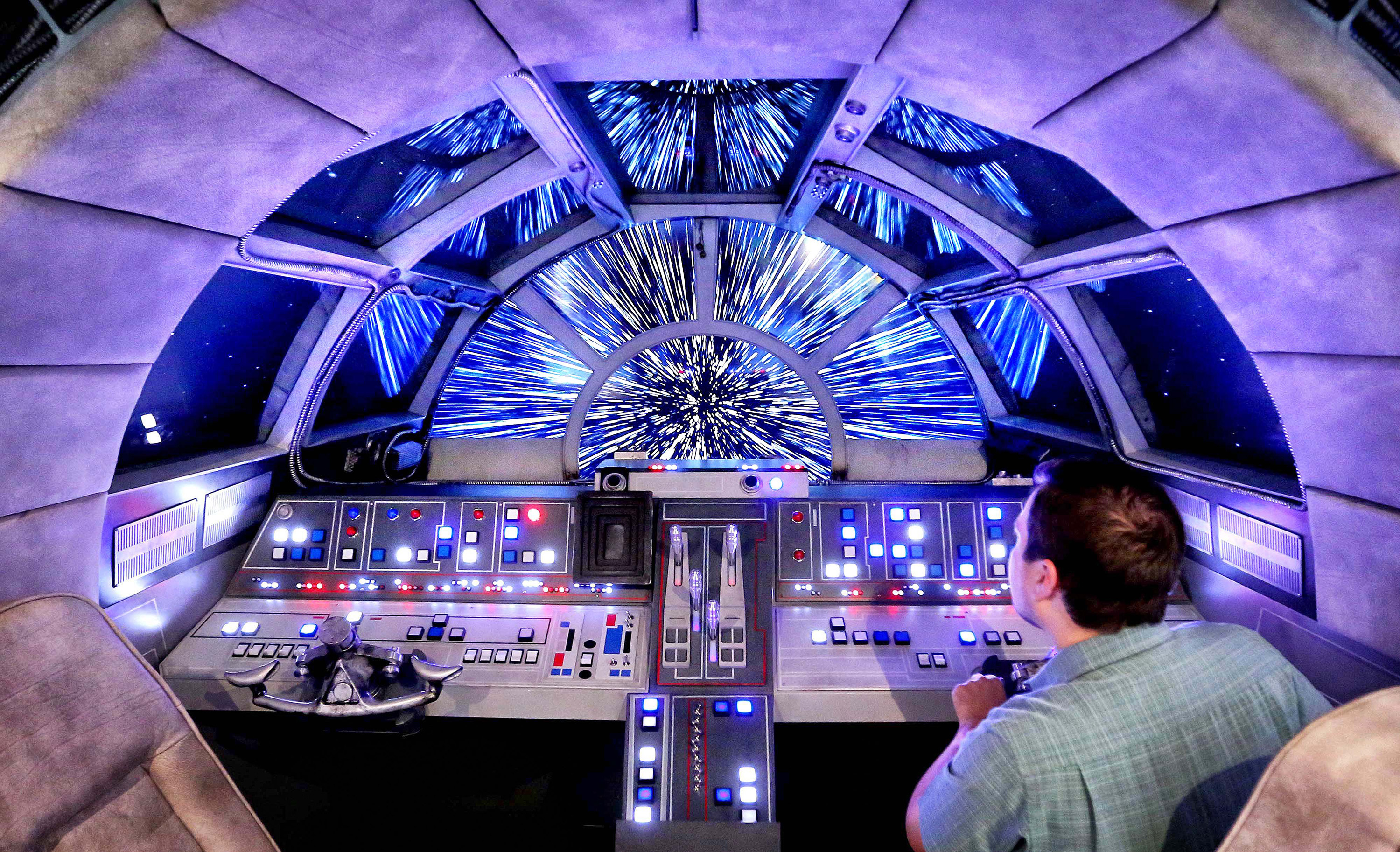 Danny Handke, a creative design executive with Walt Disney Imagineering, demonstrates the hyper reality of the cockpit in the new Star Wars Millennium Falcon play area onboard the Disney Dream, as Disney Cruise Lines unveils the enhancements to the ship on Oct. 30, 2015.