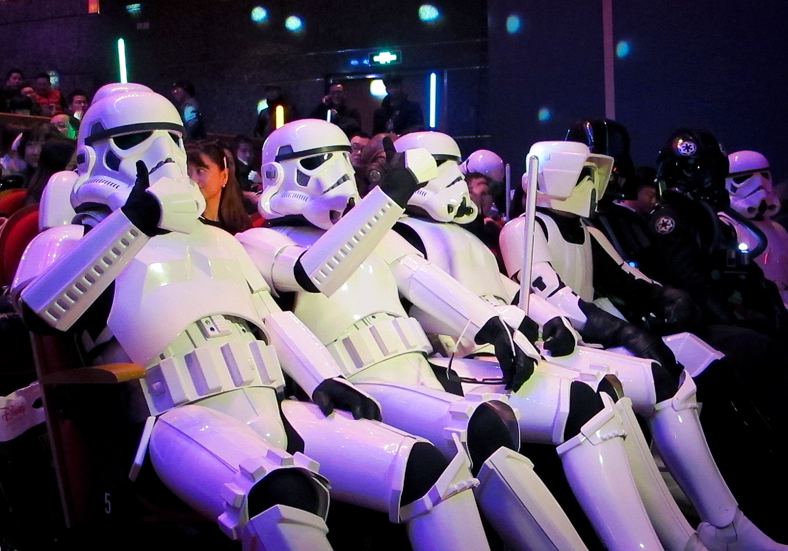 Chinese fans, dressed as Star Wars character Stormtroopers, gesture as they arrive for the premiere of  Star Wars: The Force Awakens  in Shanghai on Dec. 27, 2015.