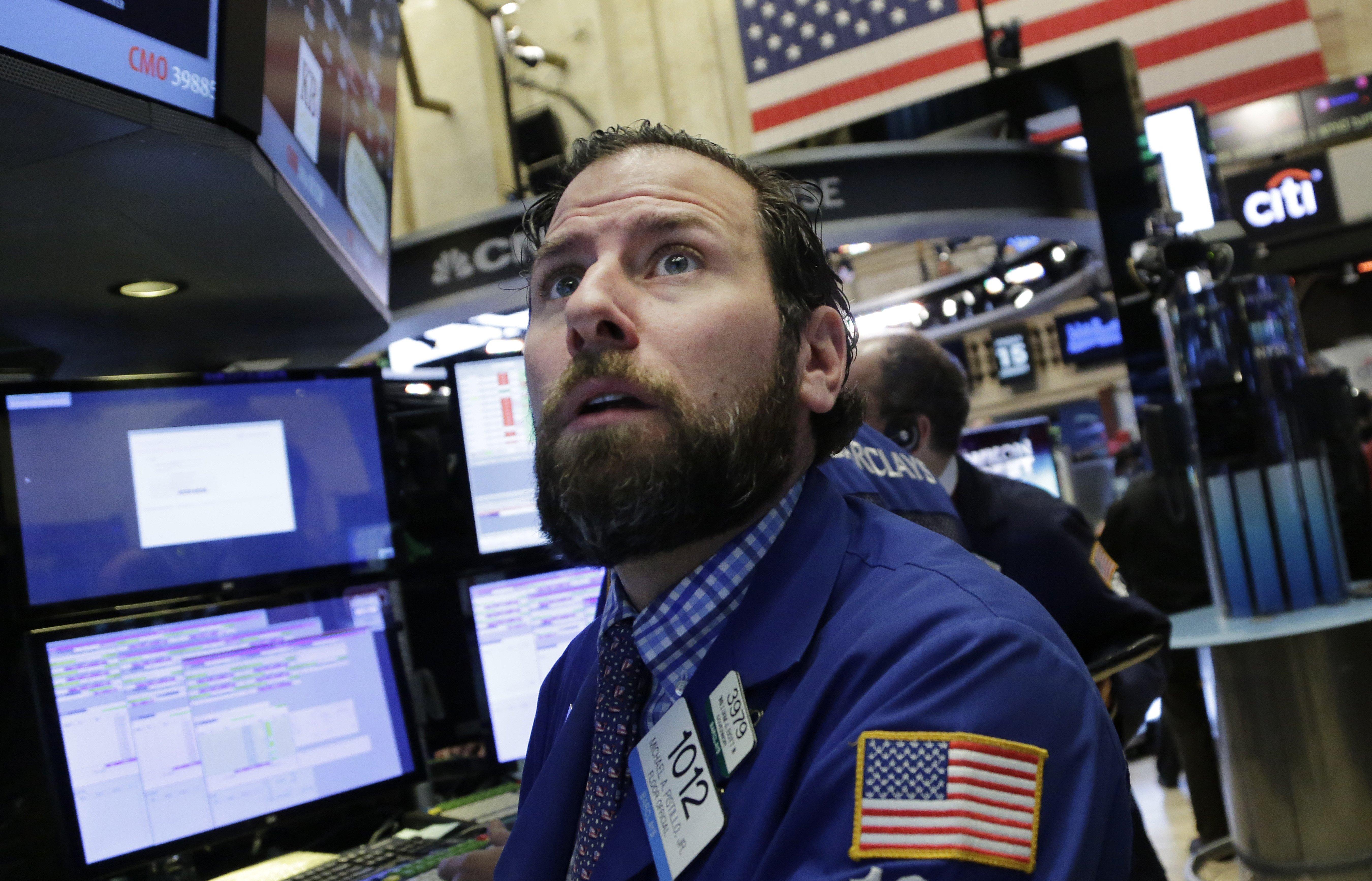 Michael Pistillo Jr. follows stock prices at the New York Stock Exchange on Jan. 15, 2016.