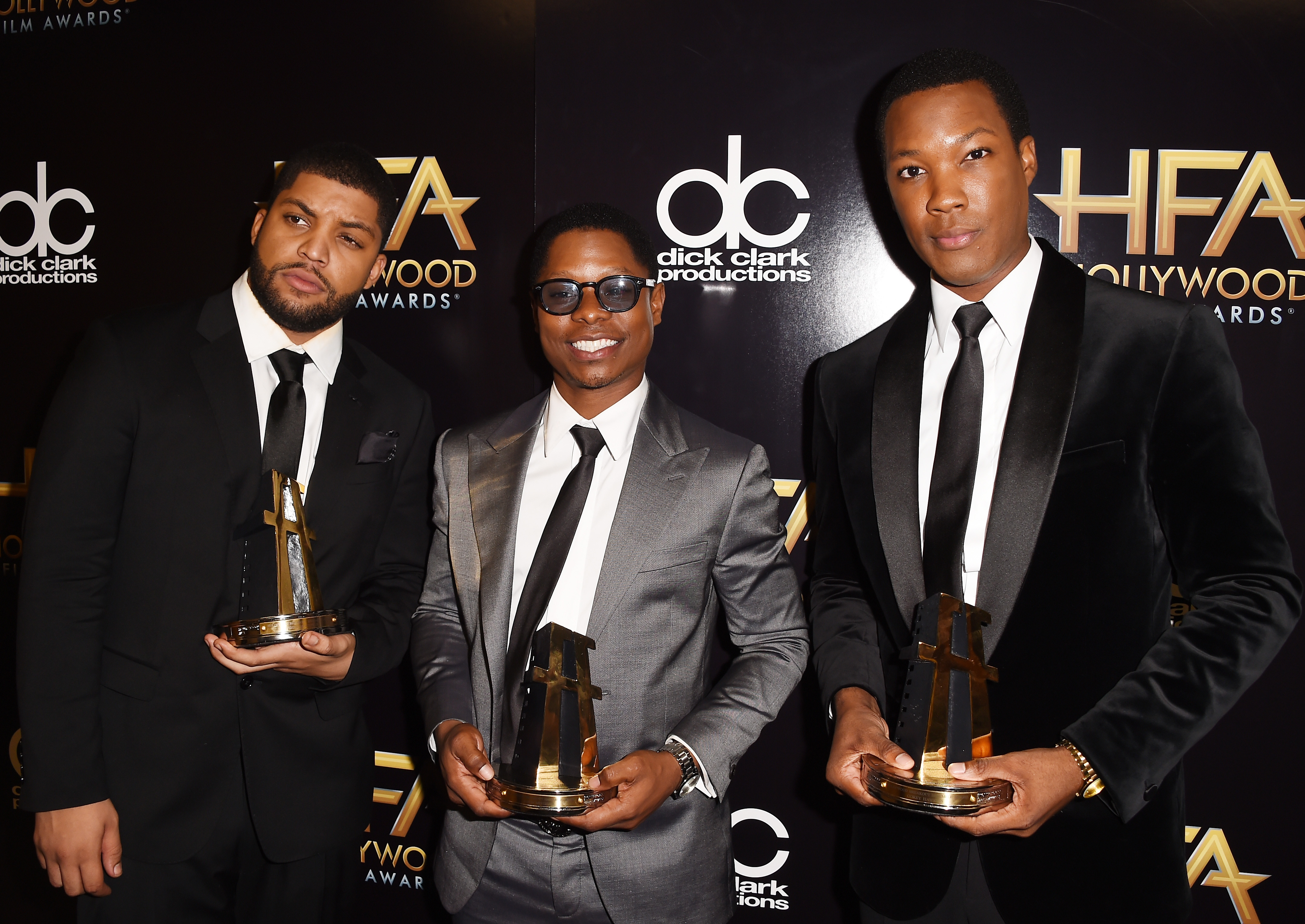 Actors O'Shea Jackson, Jason Mitchell and Corey Hawkins, winners of the Hollywood Breakout Ensemble Award for  Straight Outta Compton,  pose in the press room during the 19th Annual Hollywood Film Awards at The Beverly Hilton Hotel in Los Angeles on Nov. 1, 2015.