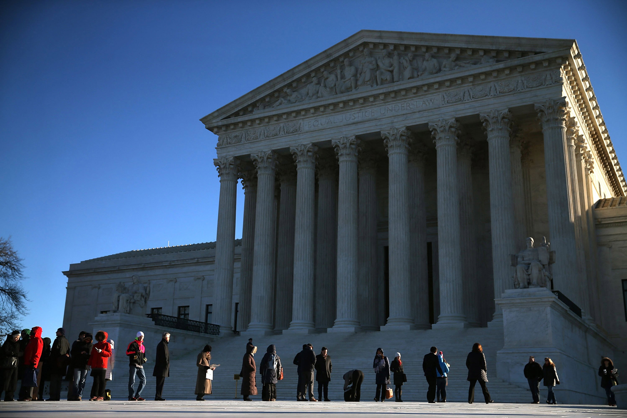 People wait in line to enter the US Supreme Court building in Washington on Jan. 11, 2016.