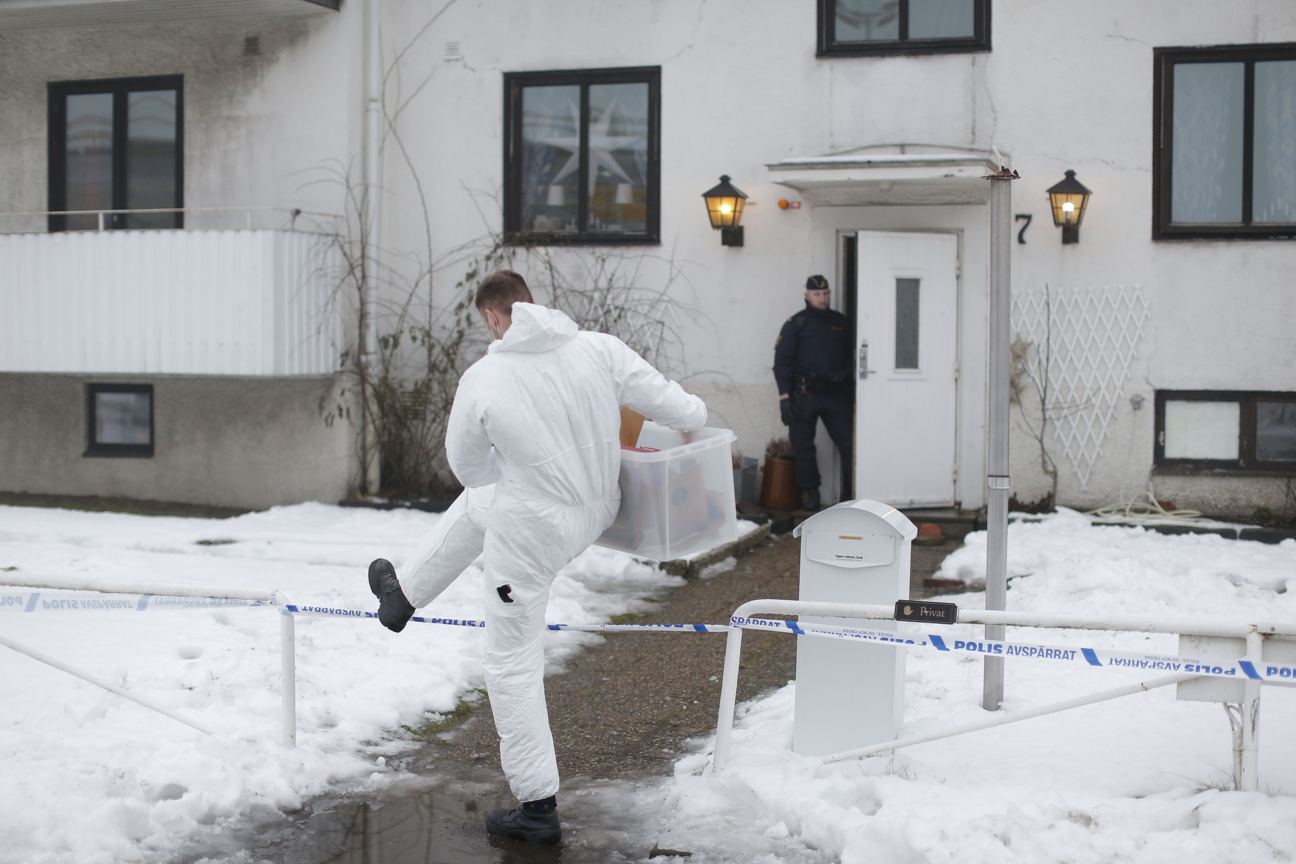 Police investigators are seen outside a home for juvenile asylum seekers in Molndal, south western Sweden on Jan. 25, 2016.