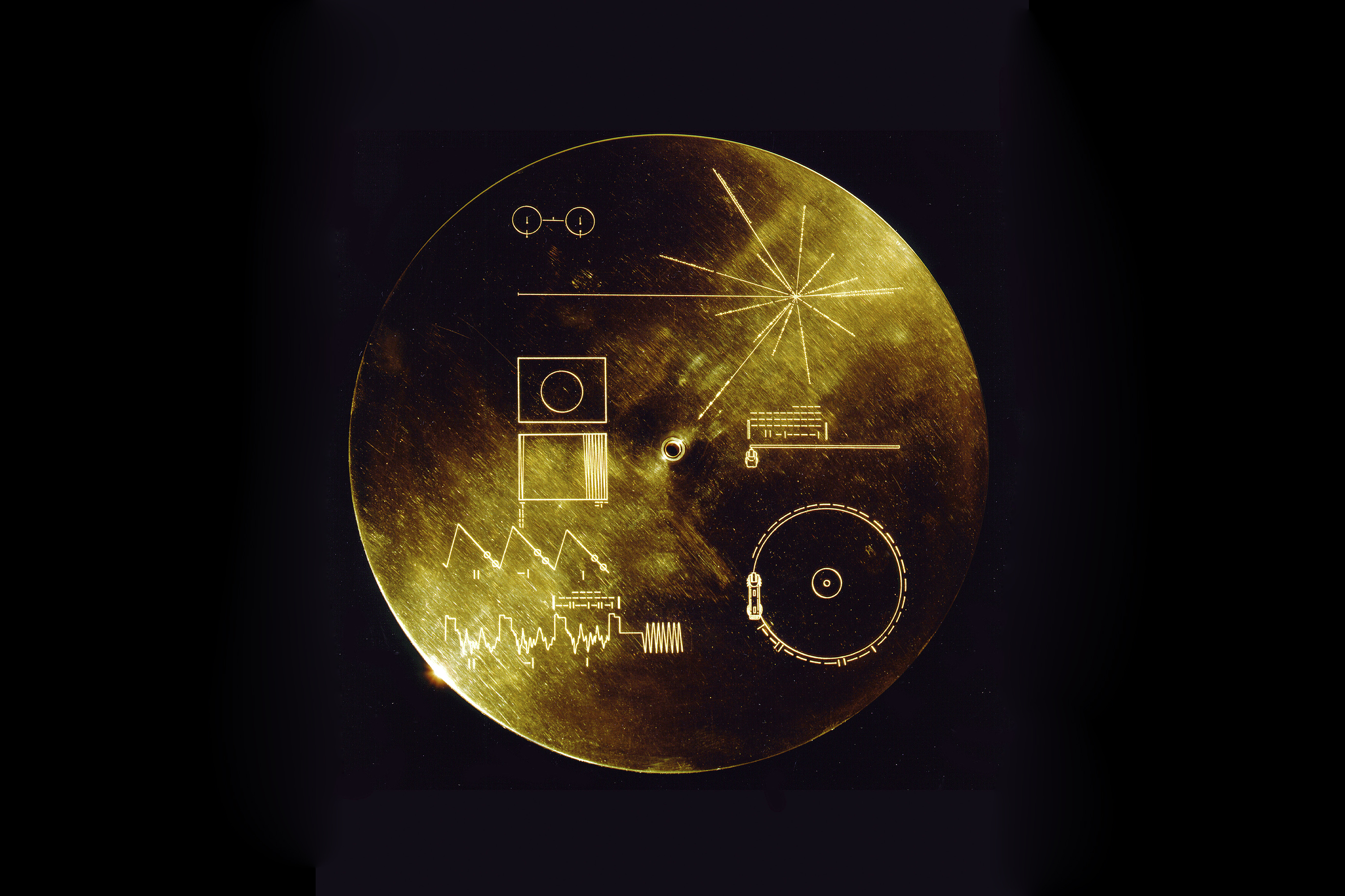 Flying aboard Voyagers 1 and 2 are identical golden records, carrying the story of Earth far into deep space. The 12 inch gold-plated copper discs contain greetings in 60 languages, samples of music from different cultures and eras, and natural and man-made sounds from Earth.