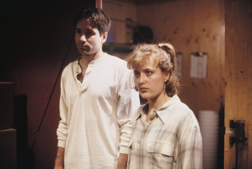 Gillian Anderson and David Duchovny are seen in a still from The X-Files in 1993.