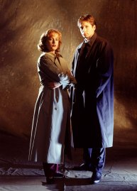 Gillian Anderson and David Duchovny are seen in a promotional still for The X-Files season 1 in 1993.