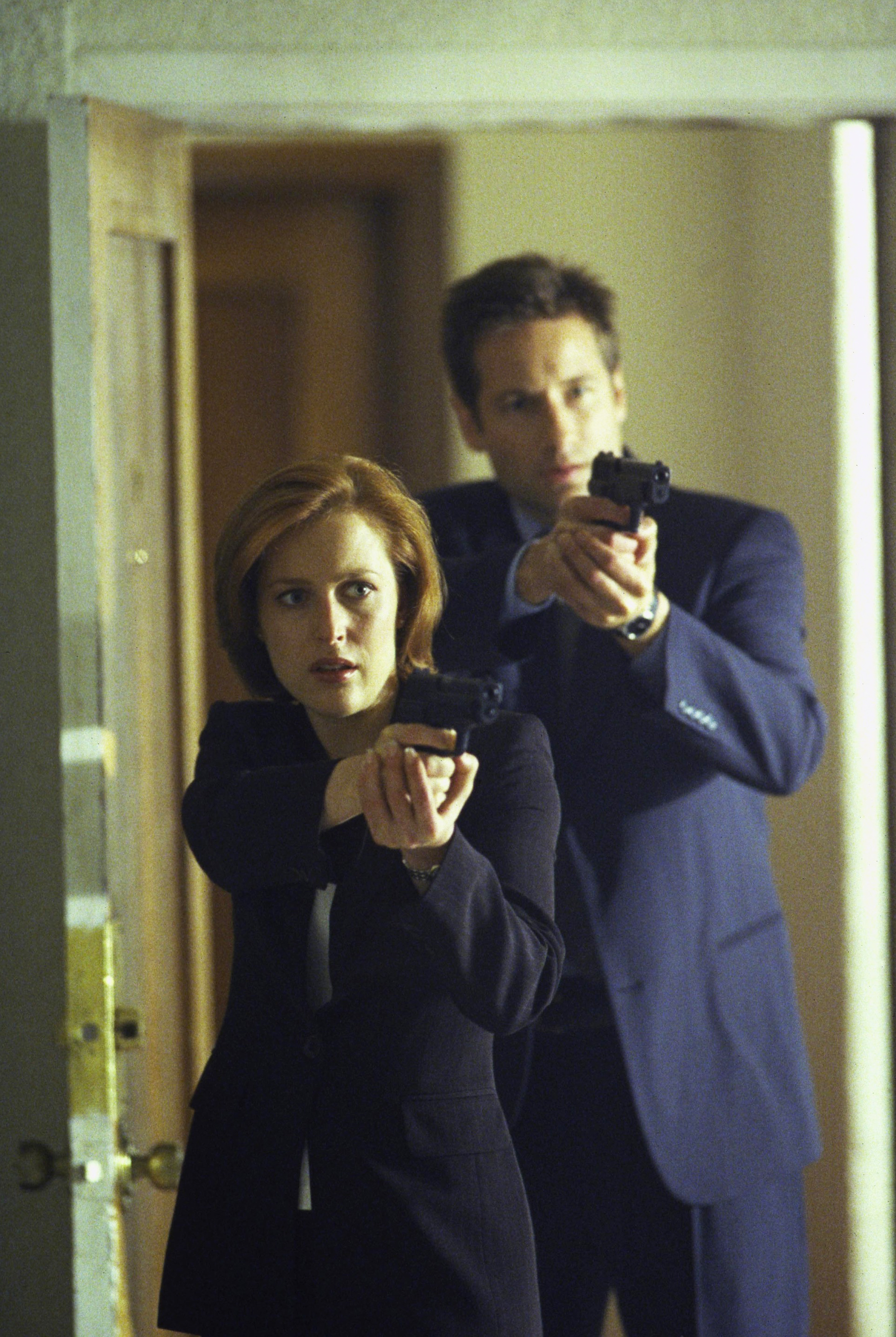 Gillian Anderson and David Duchovny are seen in <i>The X-Files</i> in 1999.