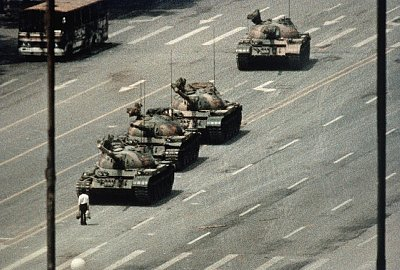 A Beijing demonstrator blocks the path of a tank convoy along the Avenue of Eternal Peace near Tiananmen Square. June 5, 1989, Beijing, China.