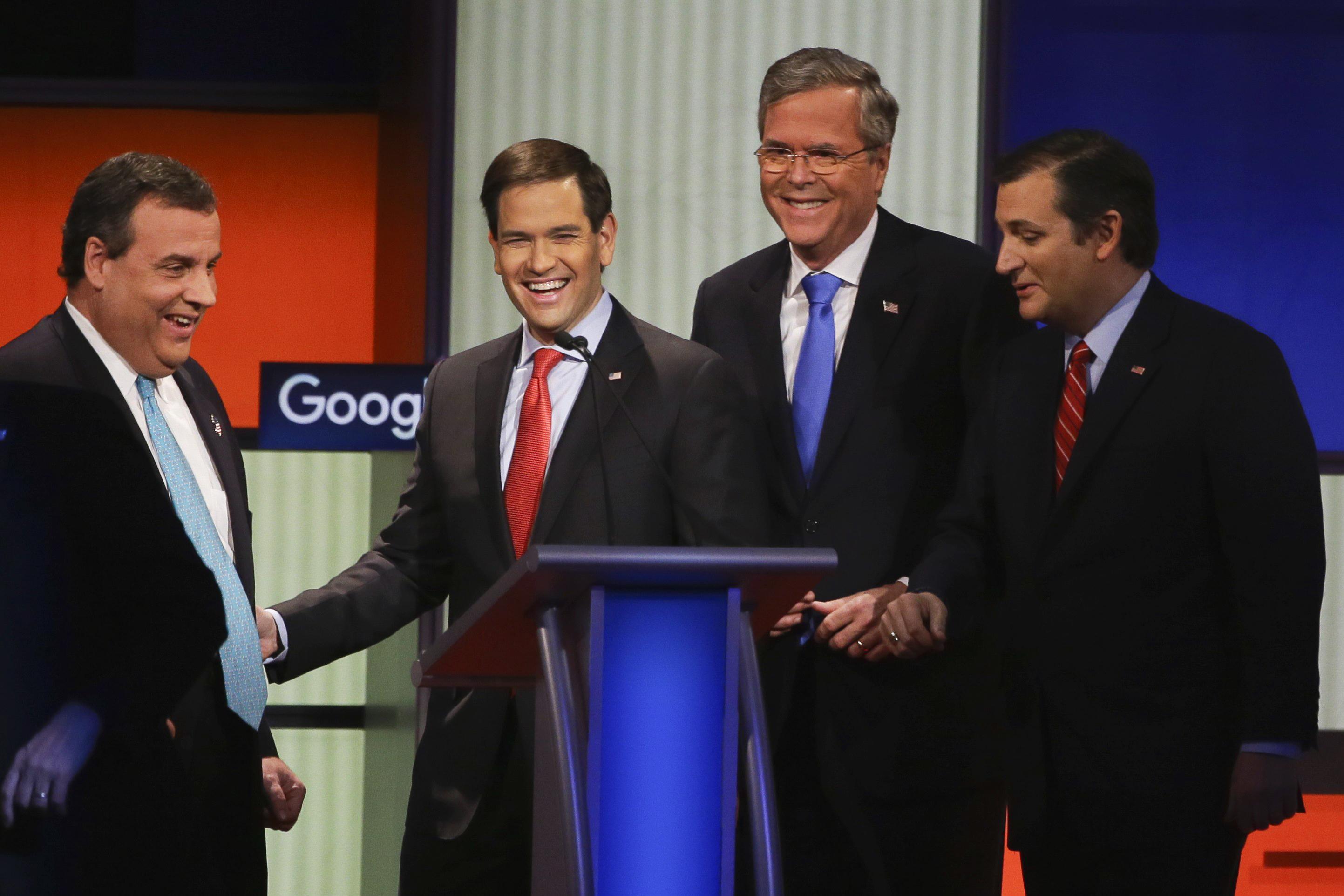 Republican presidential candidates, from left, New Jersey Gov. Chris Christie, Sen. Marco Rubio, R-Fla., former Florida Gov. Jeb Bush and Sen. Ted Cruz, R-Texas, talk after the Republican presidential primary debate, Thursday, Jan. 28, 2016, in Des Moines, Iowa.