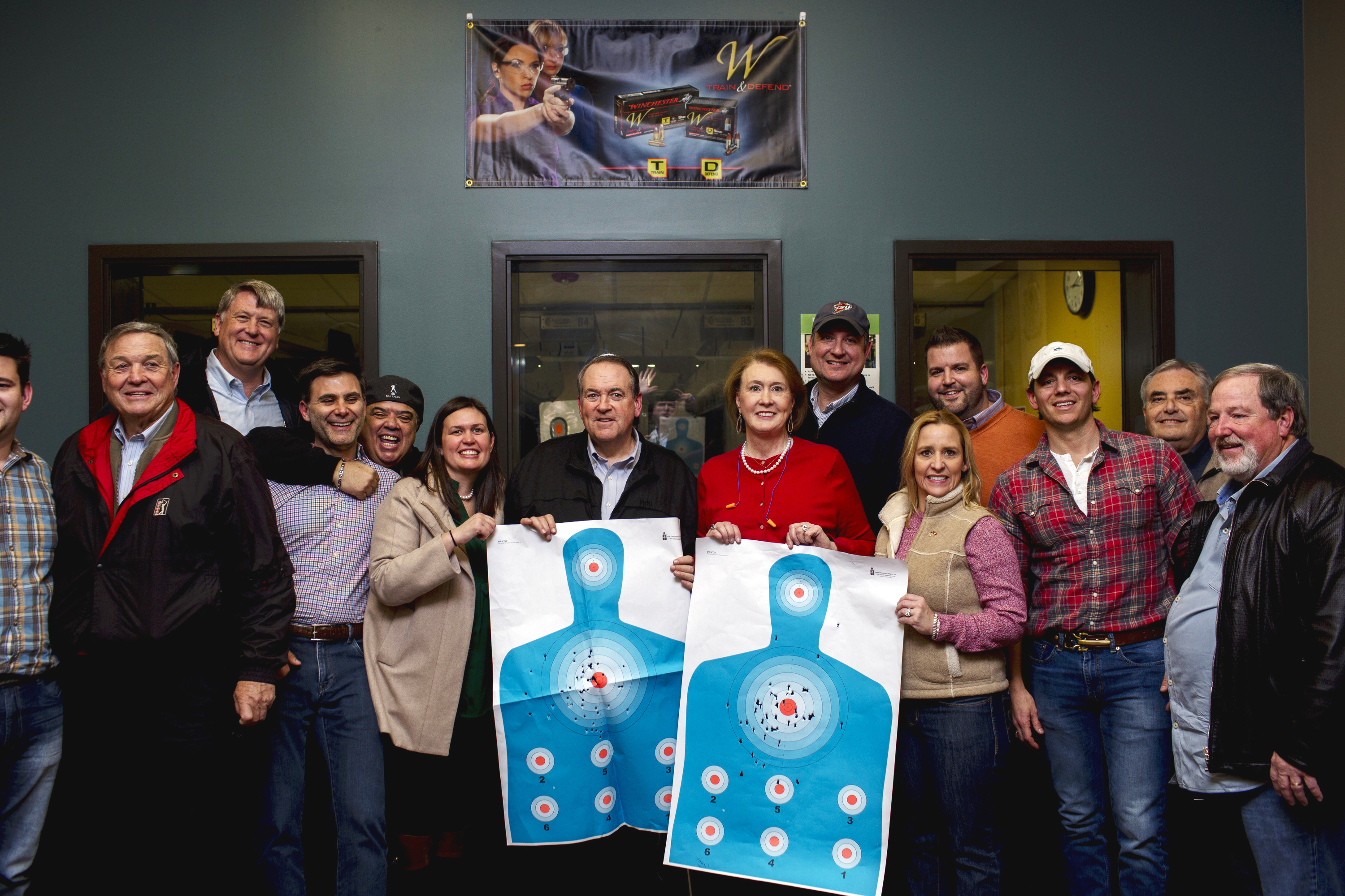 Former Arkansas Gov. Mike Huckabee and his wife, Janet, campaign at the Crossroads shooting range in Johnston, Iowa on Jan. 30, 2016.