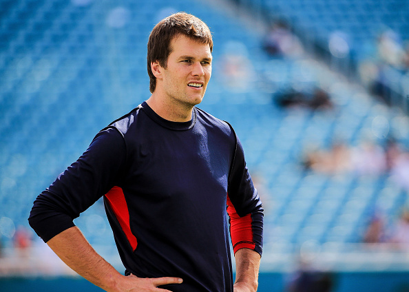 Tom Brady #12 of the New England Patriots warms up before the game against the Miami Dolphins at Sun Life Stadium on January 3, 2016, in Miami Gardens, Florida.