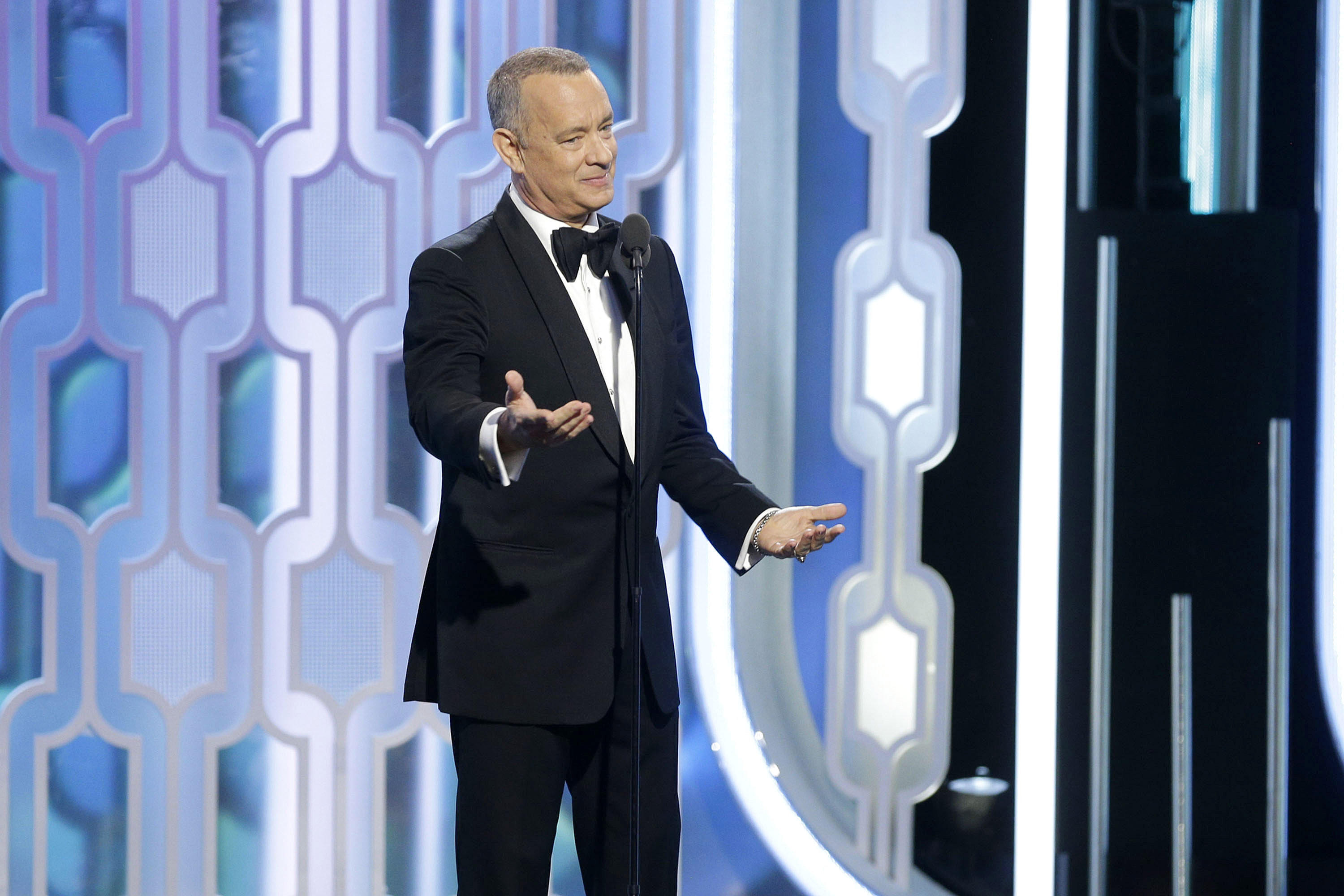 In this handout photo provided by NBCUniversal,  Presenter Tom Hanks speaks onstage during the 73rd Annual Golden Globe Awards at The Beverly Hilton Hotel on Jan. 10, 2016 in Beverly Hills, California.