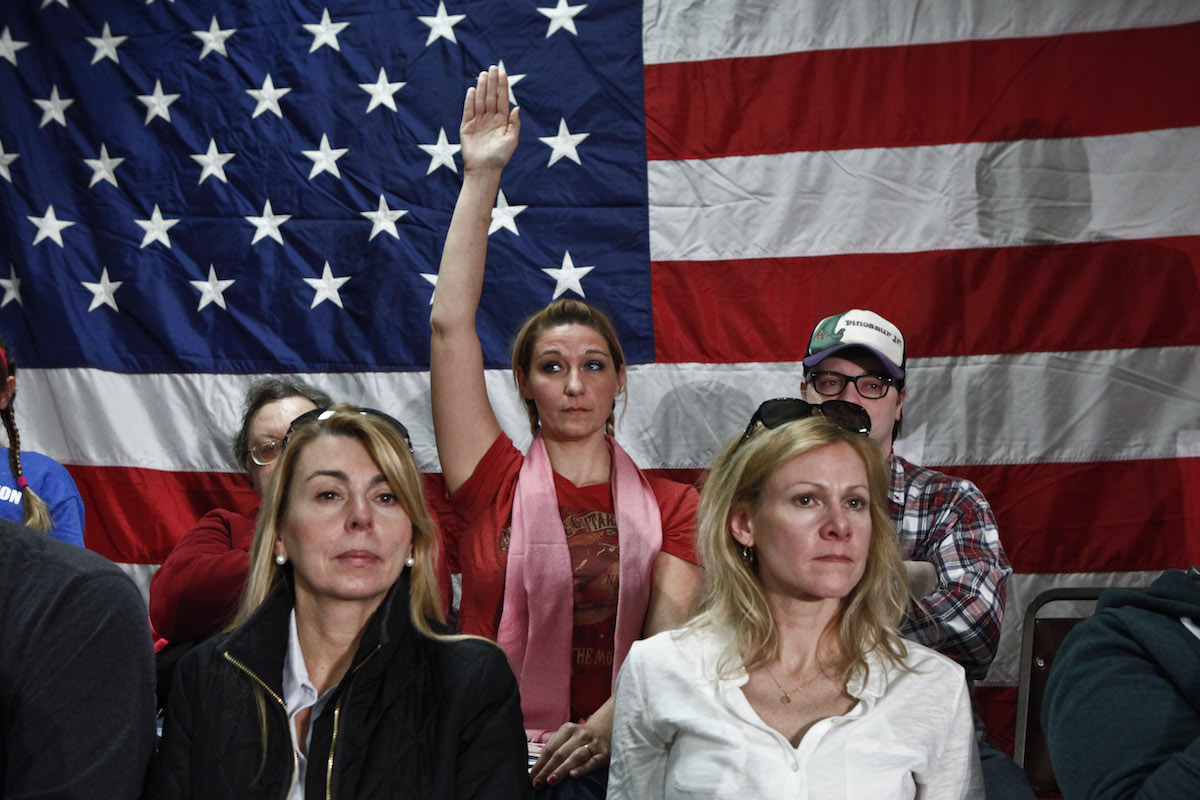 A woman raises her hand during a Town Hall meeting with New Jersey Gov. Chris Christie on Feb. 19, 2014 in Middletown, N.J.