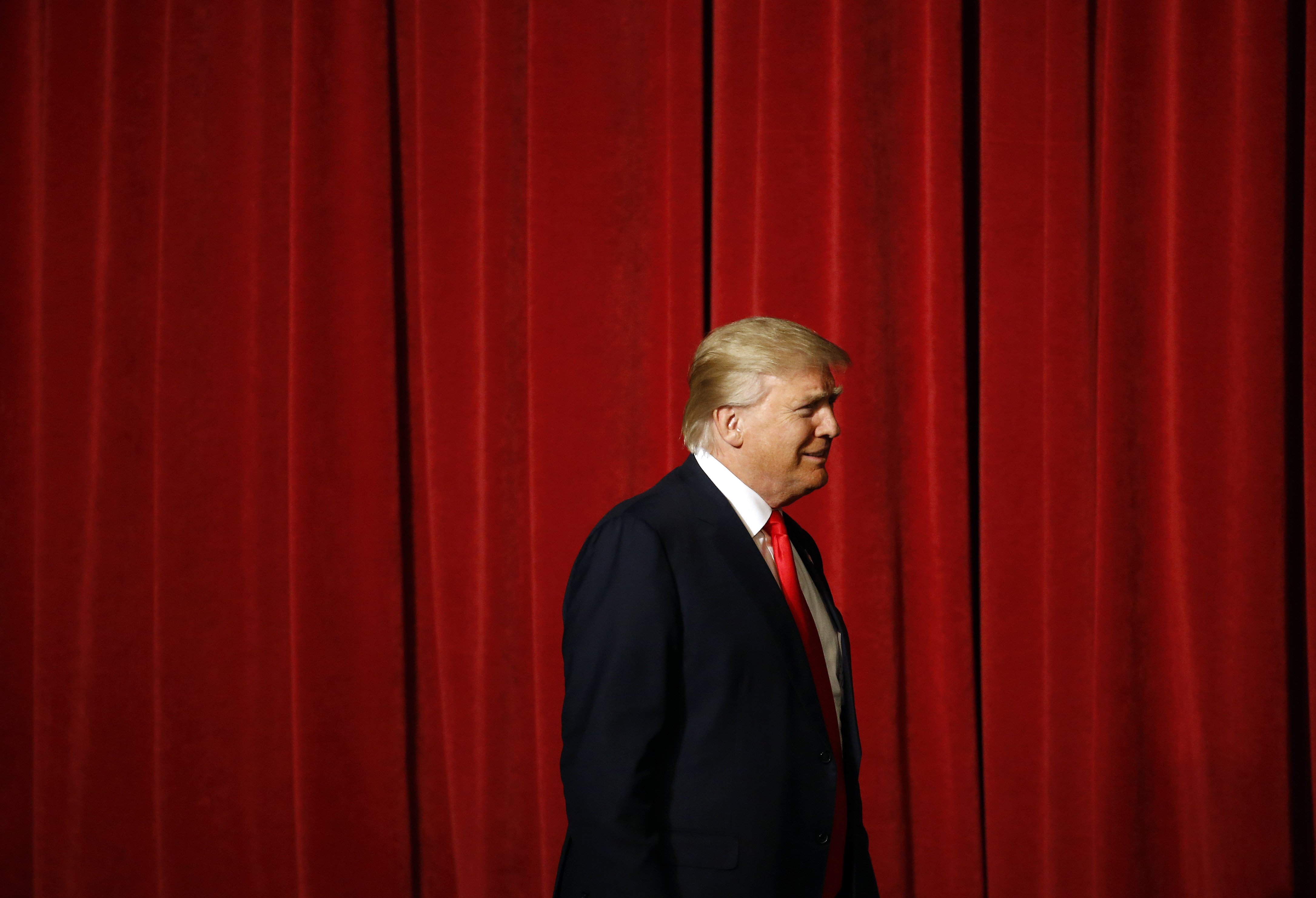 Donald Trump walks onstage for a rally at the Surf Ballroom in Clear Lake, IO on Jan. 9, 2016.
