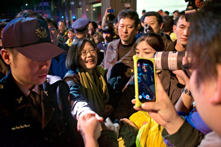 Tsai Ing-wen greets members of the public on January 16, 2016, as she leaves the DPP headquarters celebrations in Taipei, Taiwan.