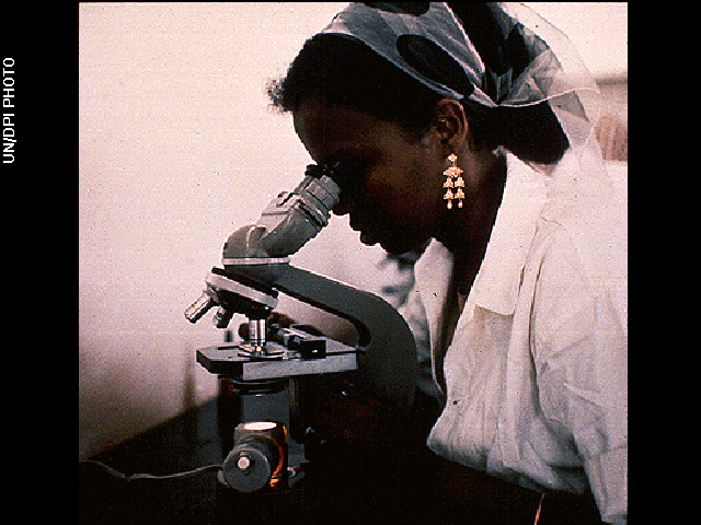 A student uses a microscope in a health center in Mogadishu, Somalia in 1970.