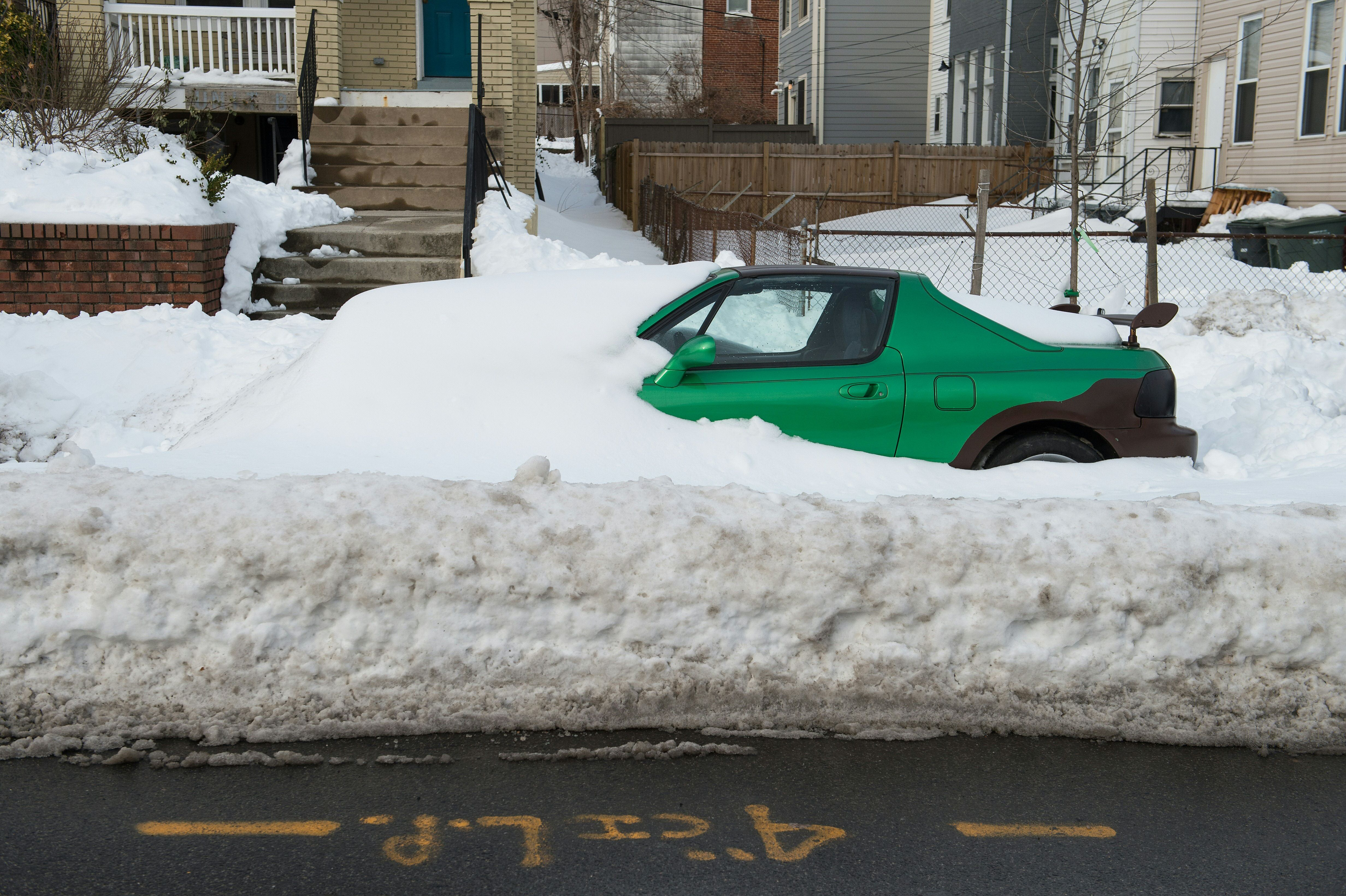 A car is stuck in snow along a street in Washington, DC, on Jan. 26.