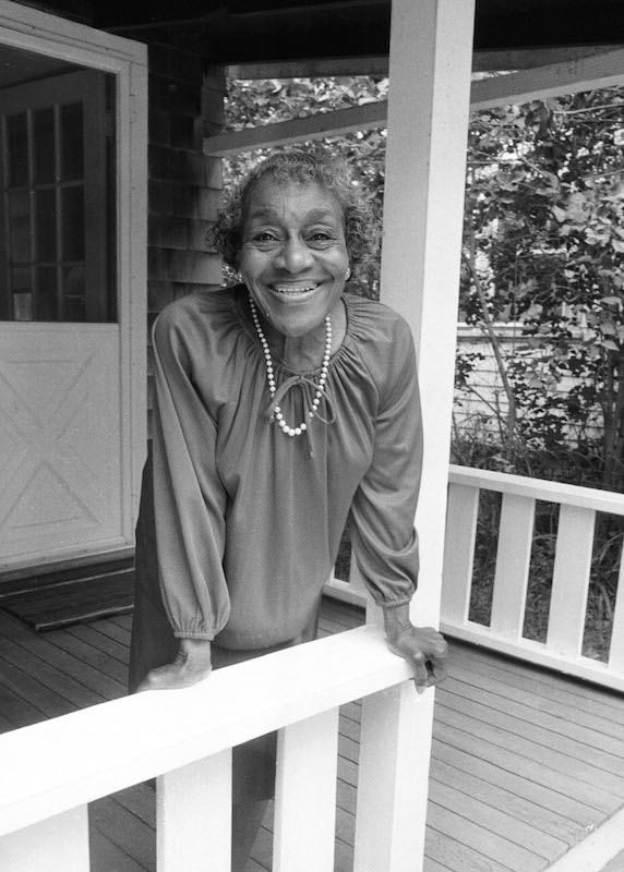 Dorothy West poses for the photographer at her home in Oak Bluffs, Mass., Aug. 5, 1989.