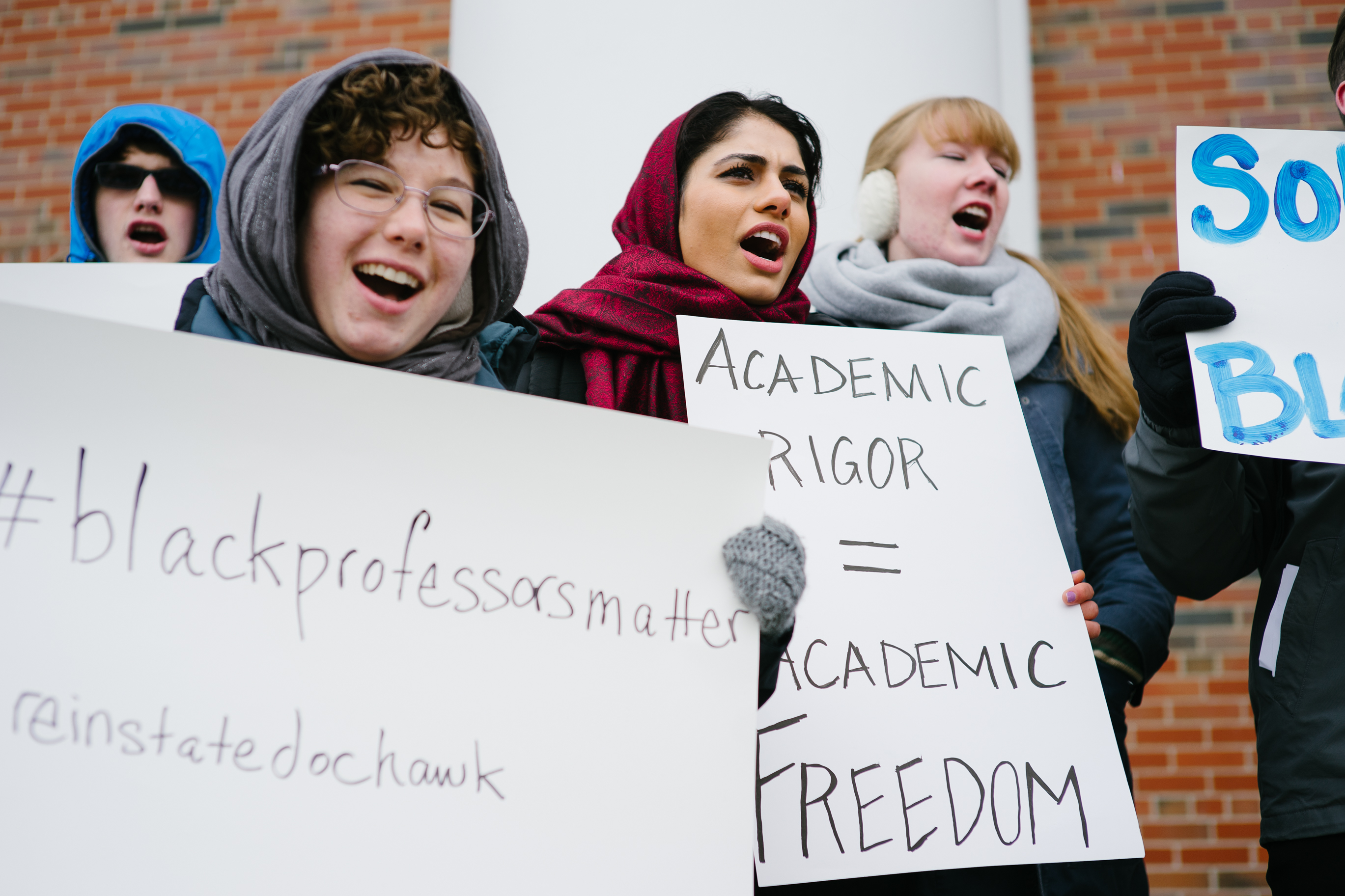 Maryam Bighash (C) participates in a show of support for Wheaton professor Larcyia Hawkins in front of Edman Chapel in Wheaton, Ill. on Jan. 11, 2016.
