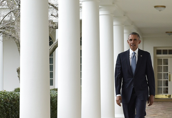 US President Barack Obama walks through the Colonnade from the Oval Office on January 12, 2016 in Washington, DC.