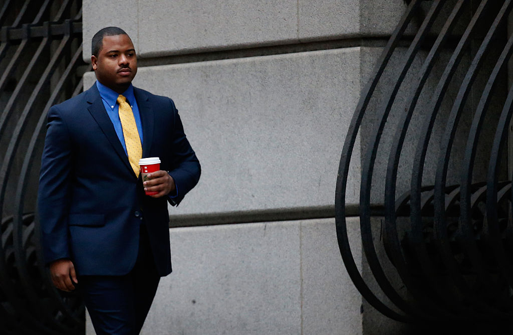 BALTIMORE, MD - NOVEMBER 30:  William Porter, one of six Baltimore city police officers charged in connection to the death of Freddie Gray earlier in the year, walks to a courthouse for jury selection in his trial on November 30, 2015 in Baltimore, Maryland.  Porter is the first to go to trial in the death of Gray who died from an injury incured in the back of a police transport van on April 19. (Photo by Rob Carr/Getty Images)