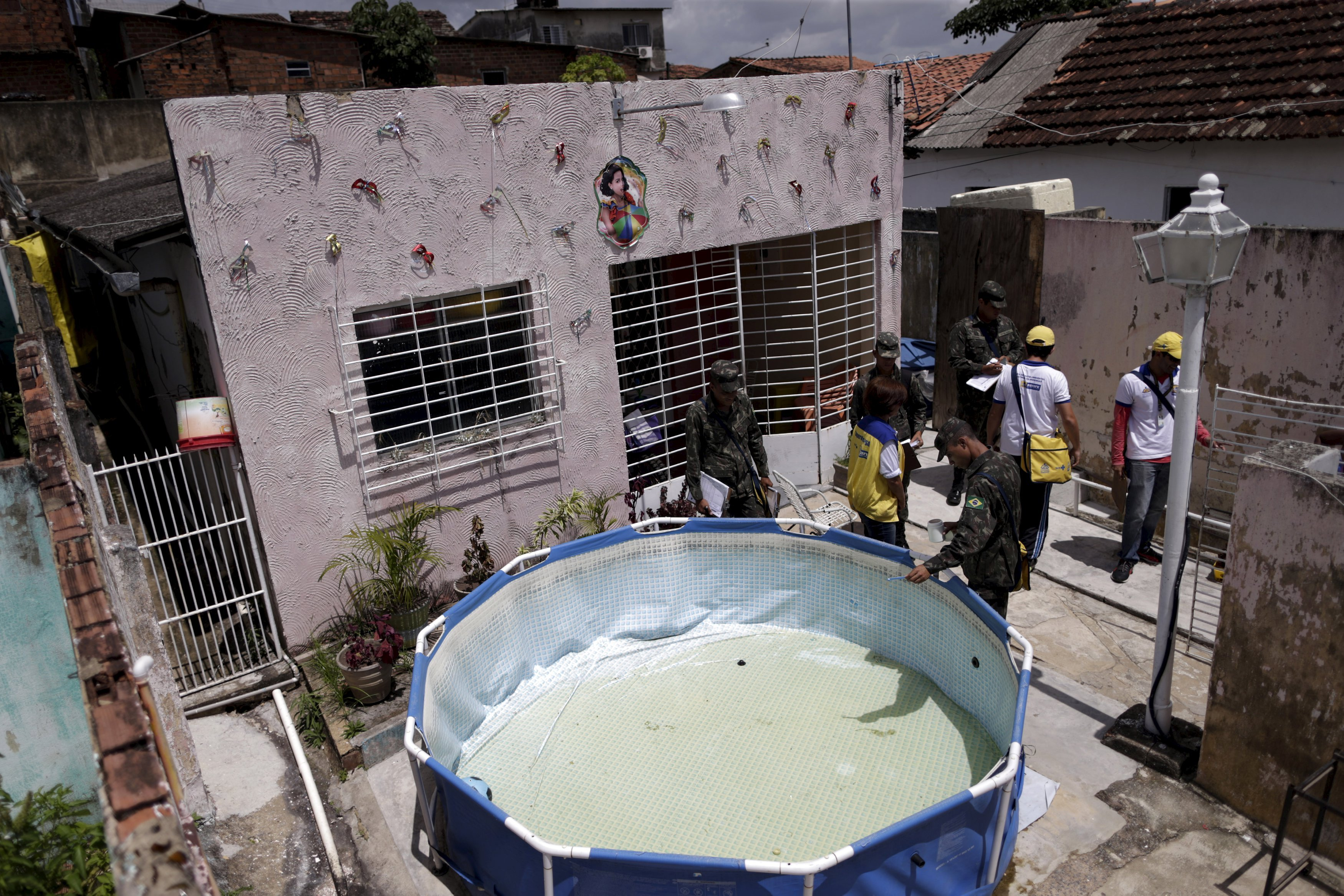 Soldiers inspect a house during an operation against the Aedes aegyti mosquito in Recife, Brazil, Jan. 27, 2016. Health authorities in the state at the center of a Zika outbreak have been overwhelmed by the surge of babies born with microcephaly, a neurological disorder associated with the mosquito-borne virus.