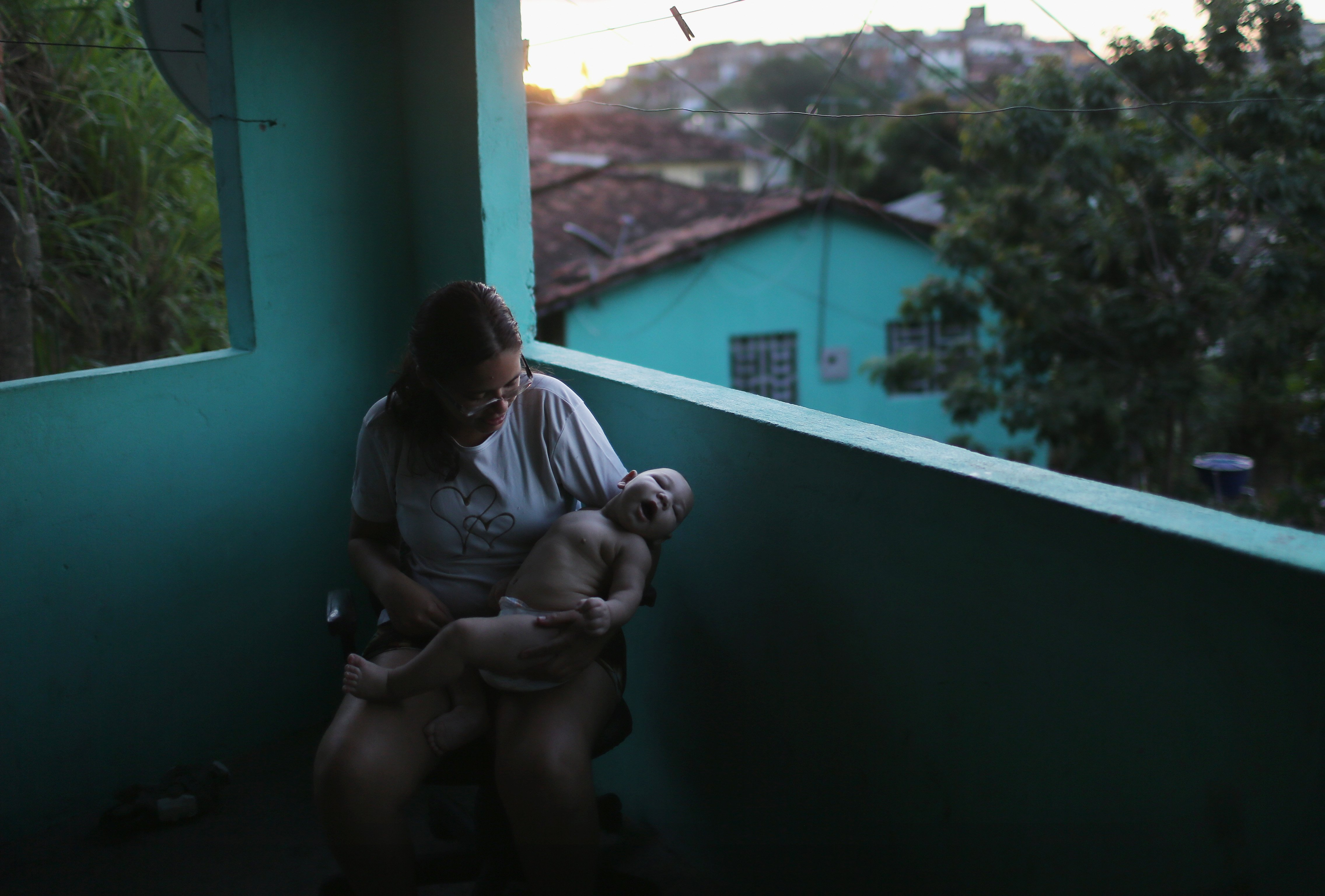 Mylene Helena Ferreira holds her son David Henrique Ferreira, who has microcephaly, on Jan. 25, 2016 in Recife, Brazil.